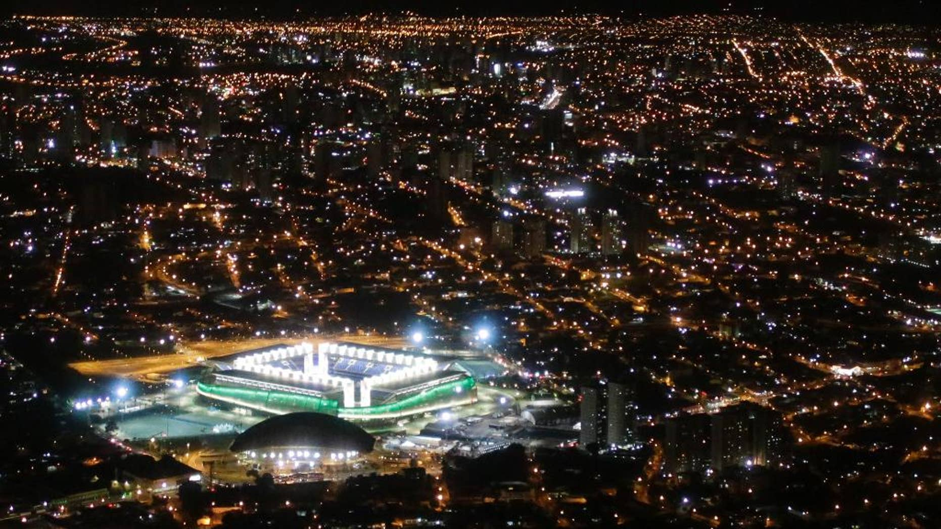 """FILE - In this June 24, 2014 file photo, a night aerial view of the Arena Pantanal stadium in Cuiaba, Brazil.  The new stadium in the western Brazilian city is being closed for """"emergency repairs"""" just seven months after it held four World Cup matches. (AP Photo/Felipe Dana, File)"""