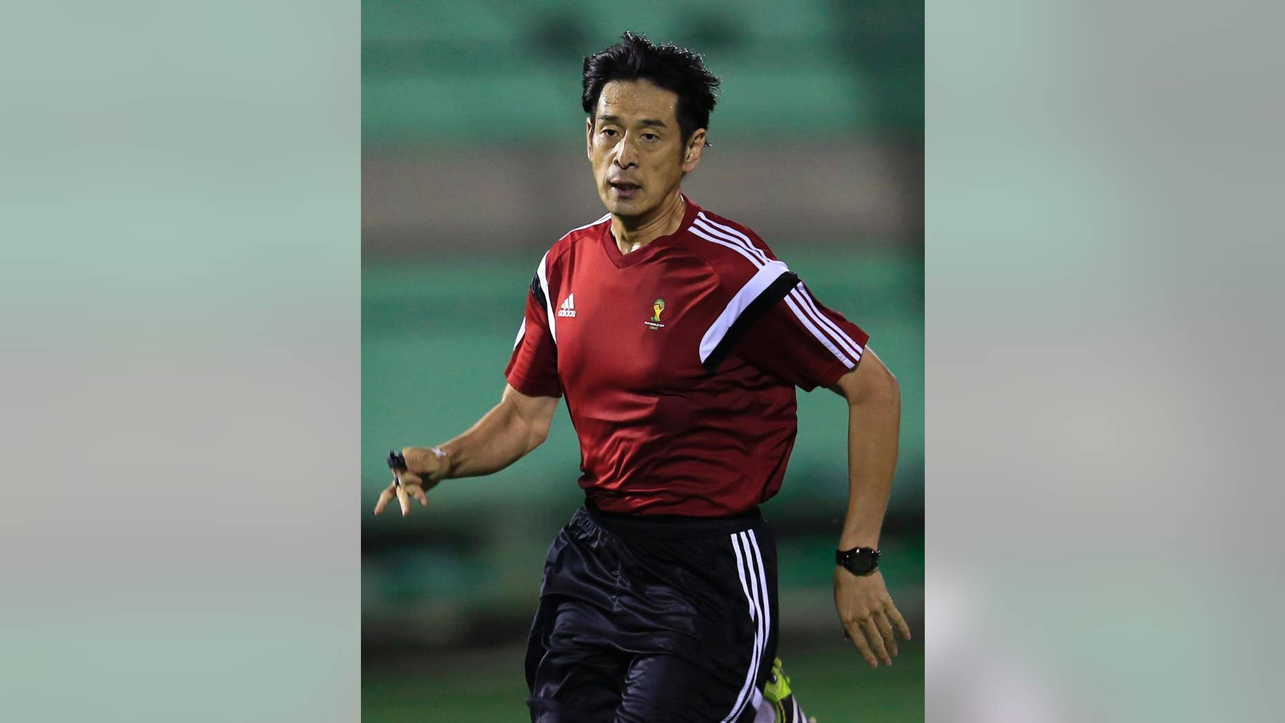 Referee Yuichi Nishimura from Japan runs during a referee's training session in Rio de Janeiro, Brazil, Friday, June 6, 2014. Brazil is hosting the World Cup soccer tournament that starts June 12. (AP Photo/Hassan Ammar)
