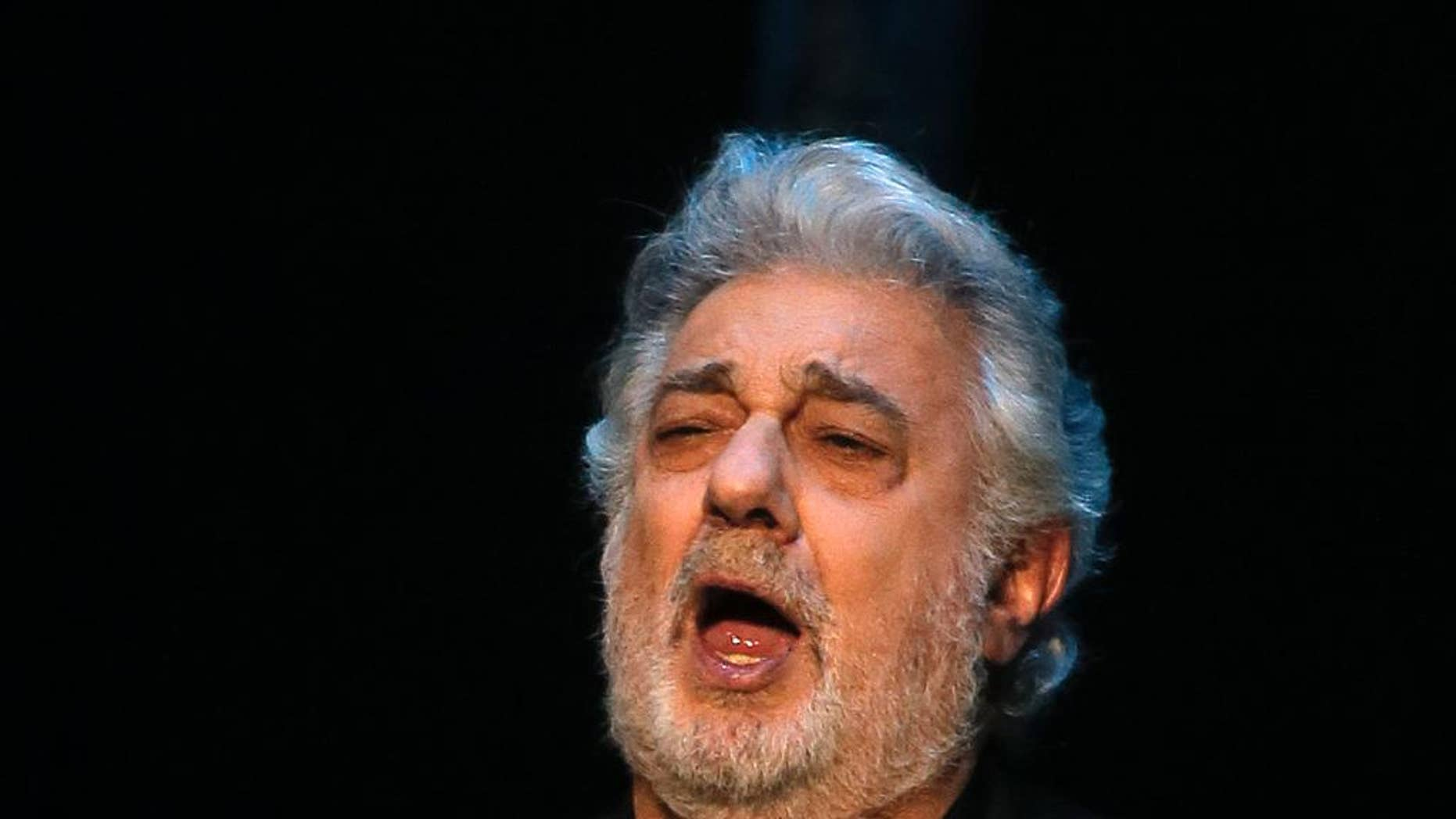 "FILE - In this May 1, 2013 file photo, Placido Domingo performs Siegmund's aria in ""The Valkyrie,"" during a pre-premiere performance, in St. Petersburg, Russia. The Spanish tenor has given a concert during nearly every single World Cup since 1990 and is gearing up for a July 11, 2014 presentation in Rio de Janeiro, just two days before the city hosts the final game. (AP Photo/Dmitry Lovetsky, File)"