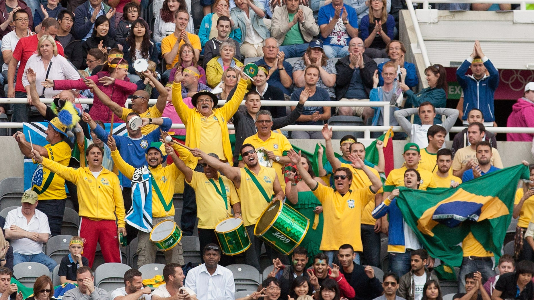 Brazil fans celebrate during a quarterfinal men's soccer match against Honduras at the London 2012 Summer Olympics, Saturday, Aug. 4, 2012, at St James Park in Newcastle, England. (AP Photo/Chris Clark)