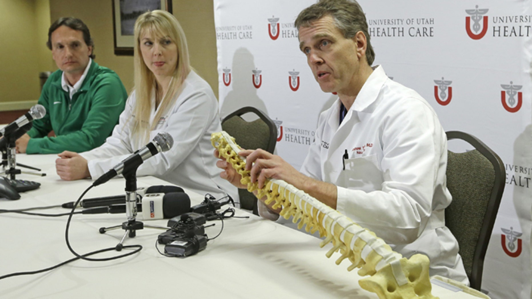 University of Utah neurosurgeon Andrew Dailey, right, describes the injury of Brazilian gymnast Lais Souza, as Brazilian team doctor Antonio Marttos, left, and Dr. Holly Ledyard, member of the University of Utah Neuro Critical Care Unit, looks on, during a news conference at the University of Utah Thursday, Jan. 30, 2014, in Salt Lake City. Doctors say the 25-year-old gymnast, expected to compete in freestyle skiing at the Sochi Olympics, is unable to move, talk or breathe on her own after an accident this week while skiing in Utah.  She was injured Monday when she hit a tree while skiing in Park City.(AP Photo)
