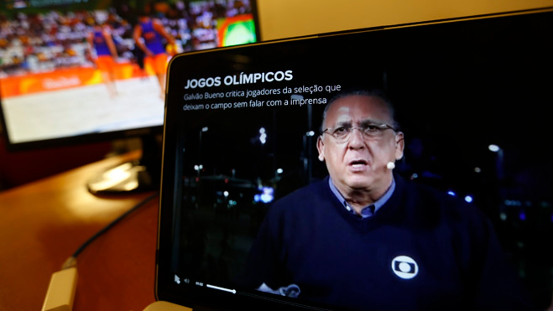 Carlos Eduardo dos Santos Galvao Bueno, chief sports commentator for Globo, is seen on a screen in Rio de Janeiro, Brazil, Monday, Aug. 15, 2016. When a BBC announcer suggested that the Brazilian broadcaster needed to shut up at the start of a swimming race at the Rio Olympics, he was voicing the feelings of many in the host country. Considered the Bob Costas of Brazil, Carlos Eduardo dos Santos Galvao Bueno, known here simply as Galvao, is a love-him-or-hate-him announcer who is the voice of Brazilian sports. His raucous, over-the-top style helps make big sporting events feel even bigger in Brazil. (AP Photo/Silvia Izquierdo)