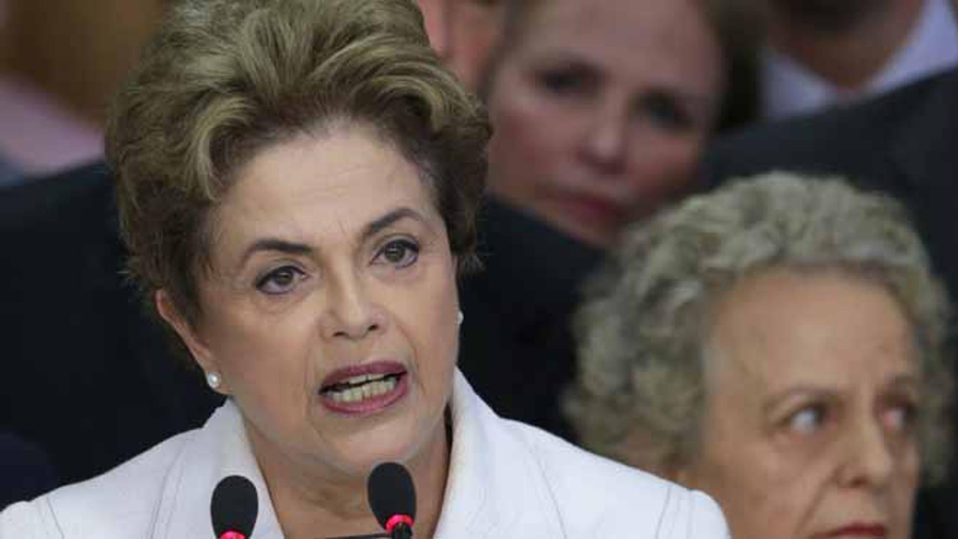Brazil's President Dilma Rousseff addresses the nation at Planalto presidential palace in Brasilia, Brazil, Thursday, May 12, 2016.