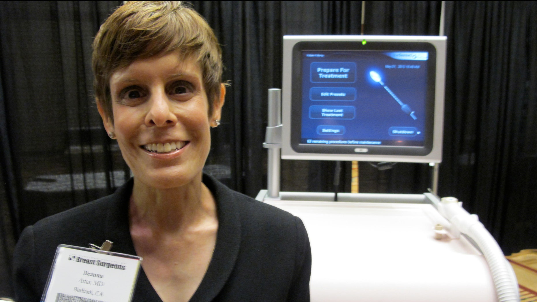 Dr. Deanna Attai, who is on the board of directors for American Society of Breast Surgeons, stands in front of cryoablation machine at the American Society of Breast Surgeons conference on May 1, 2013 in Chicago.