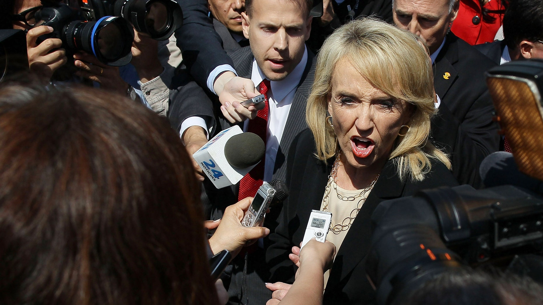 WASHINGTON, DC - APRIL 25:  Arizona Gov. Jan Brewer speaks to the media after arguments at the U.S. Supreme Court, on April 25, 2012 in Washington, DC. This morning the high court will heard arguments on Arizona v. United States and will be tasked with deciding the conflicting roles of national and state governments in controlling the lives of noncitizens living illegally in the U.S.while deciding the constitutionality of Arizona's immigration law SB 1070.  (Photo by Mark Wilson/Getty Images)