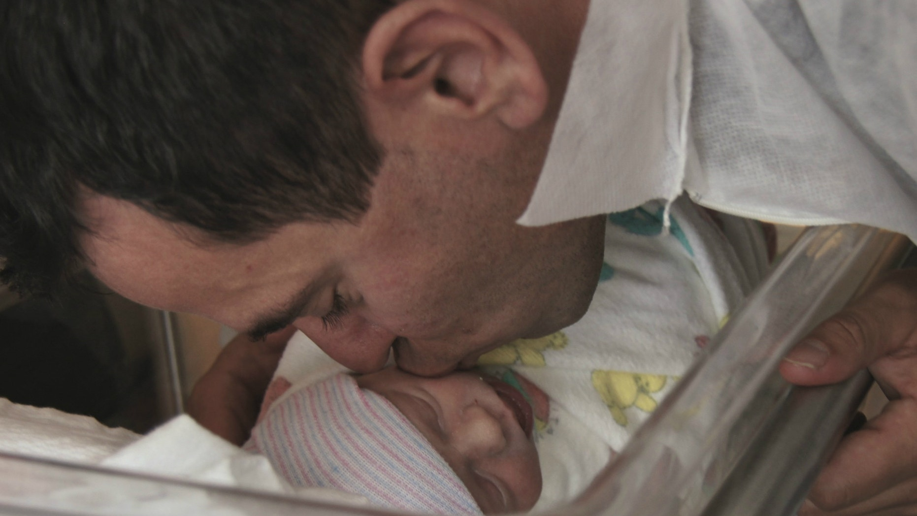 Brian Lande and his newborn son.