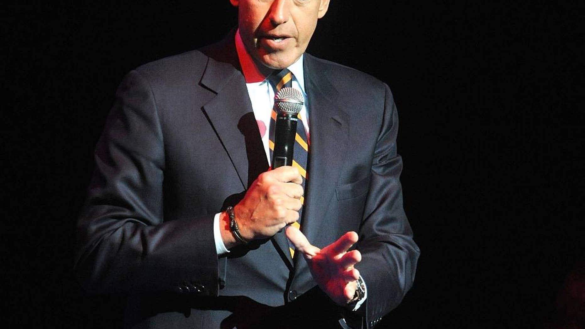 FILE - In this Nov. 5, 2014, file photo, Brian Williams speaks at the 8th Annual Stand Up For Heroes, presented by New York Comedy Festival and The Bob Woodruff Foundation in New York. Suspended NBC News anchor Williams and his wife attended a fundraiser, Saturday, March 21, 2015, and donated $50,000 in a bid to keep his Catholic high school in New Jersey, Mater Dei Prep, from closing. The school announced in February it will close in June because of financial problems unless it can raise $1 million. (Photo by Brad Barket/Invision/AP, File)