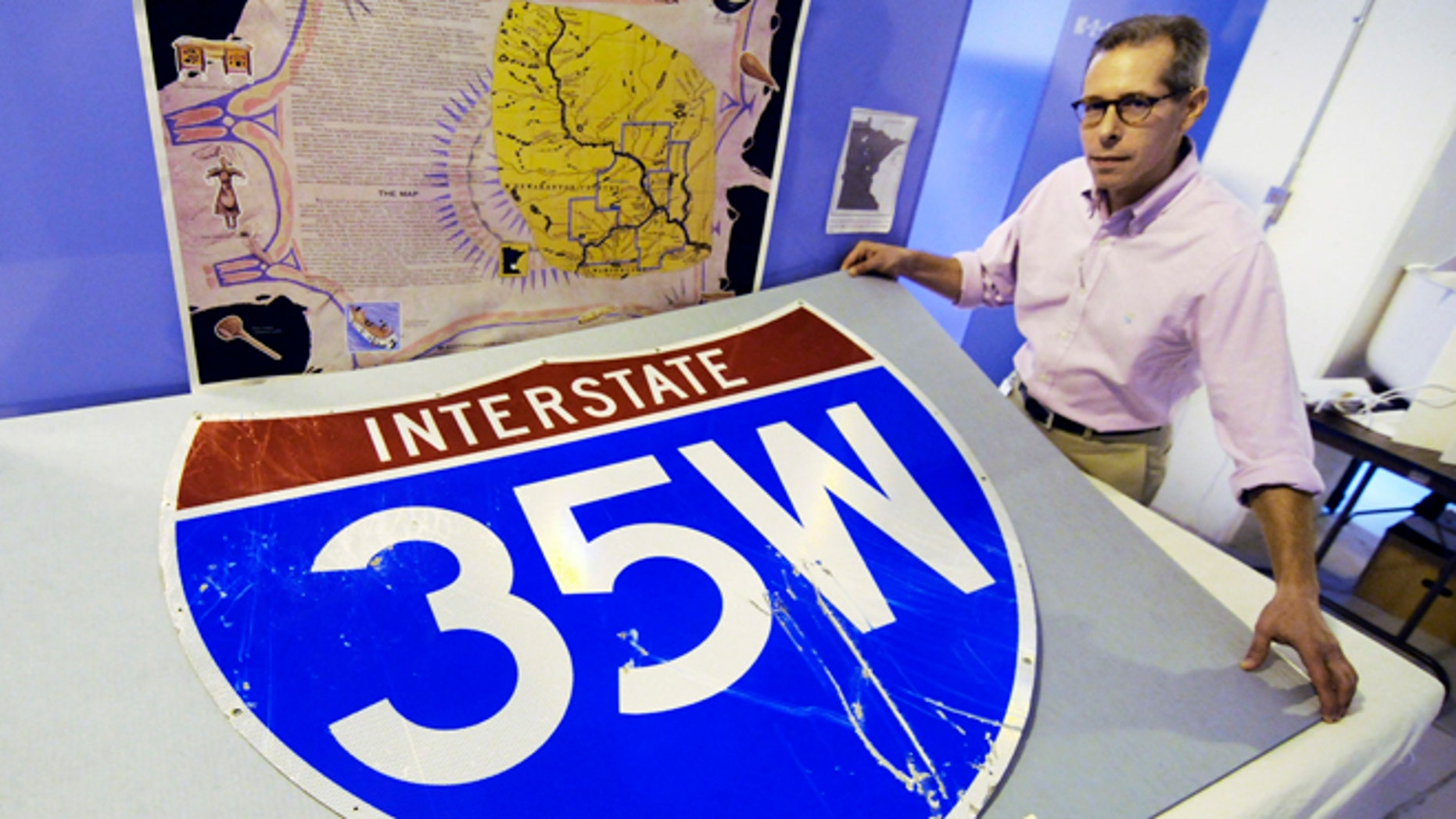 Thursday, July 26, 2012: In this photo in St. Paul, Minn., Minnesota History Center senior curator Adam Scher shows the bridge highway sign, one of the collection of artifacts at the History Center from the Aug. 1, 2007 Interstate 35W bridge collapse in Minneapolis.