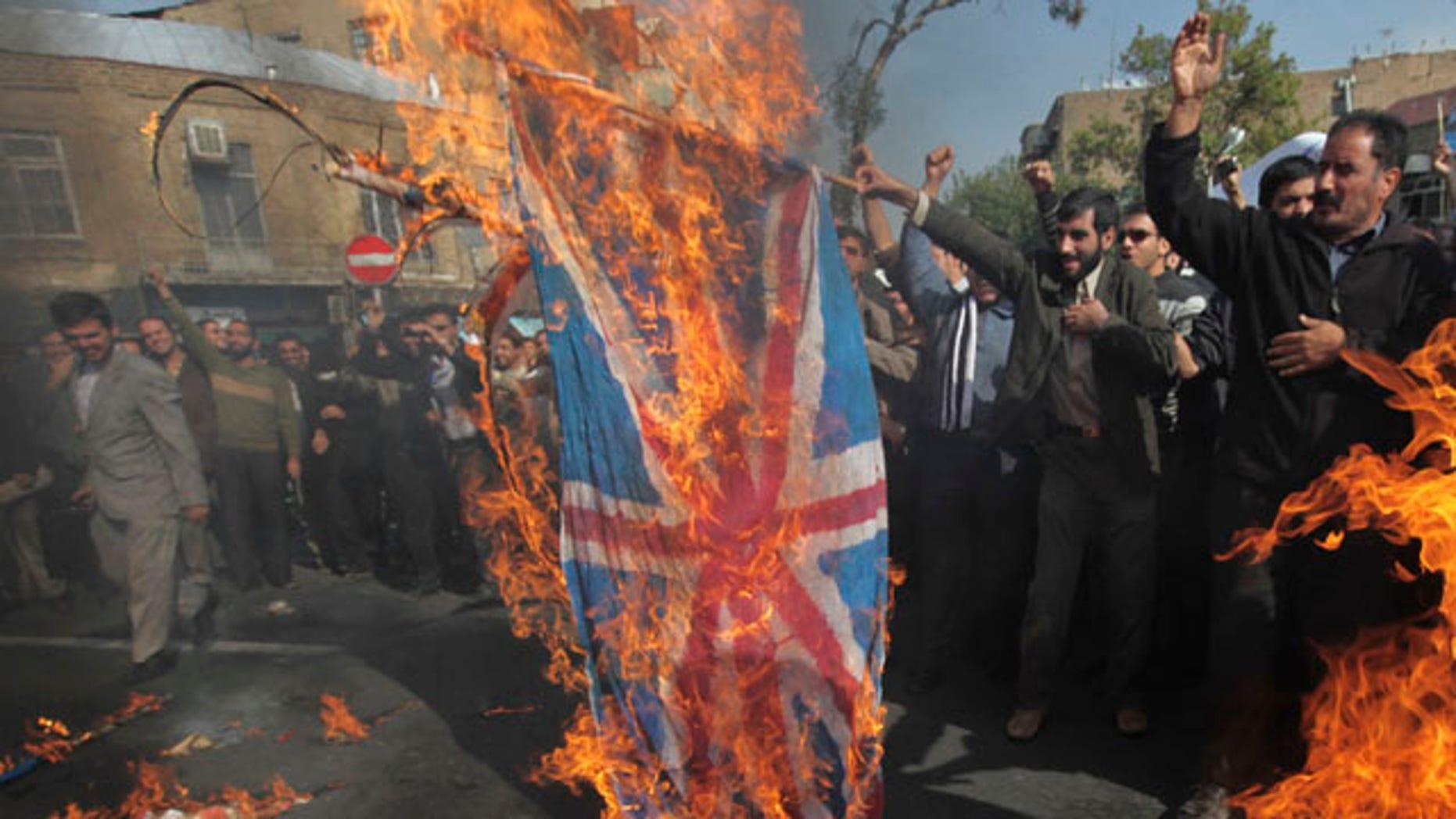 Nov. 4: Iranian  protestors burn representative of the British flag during an anti-British demonstration in front of the British Embassy in Tehran, Iran.