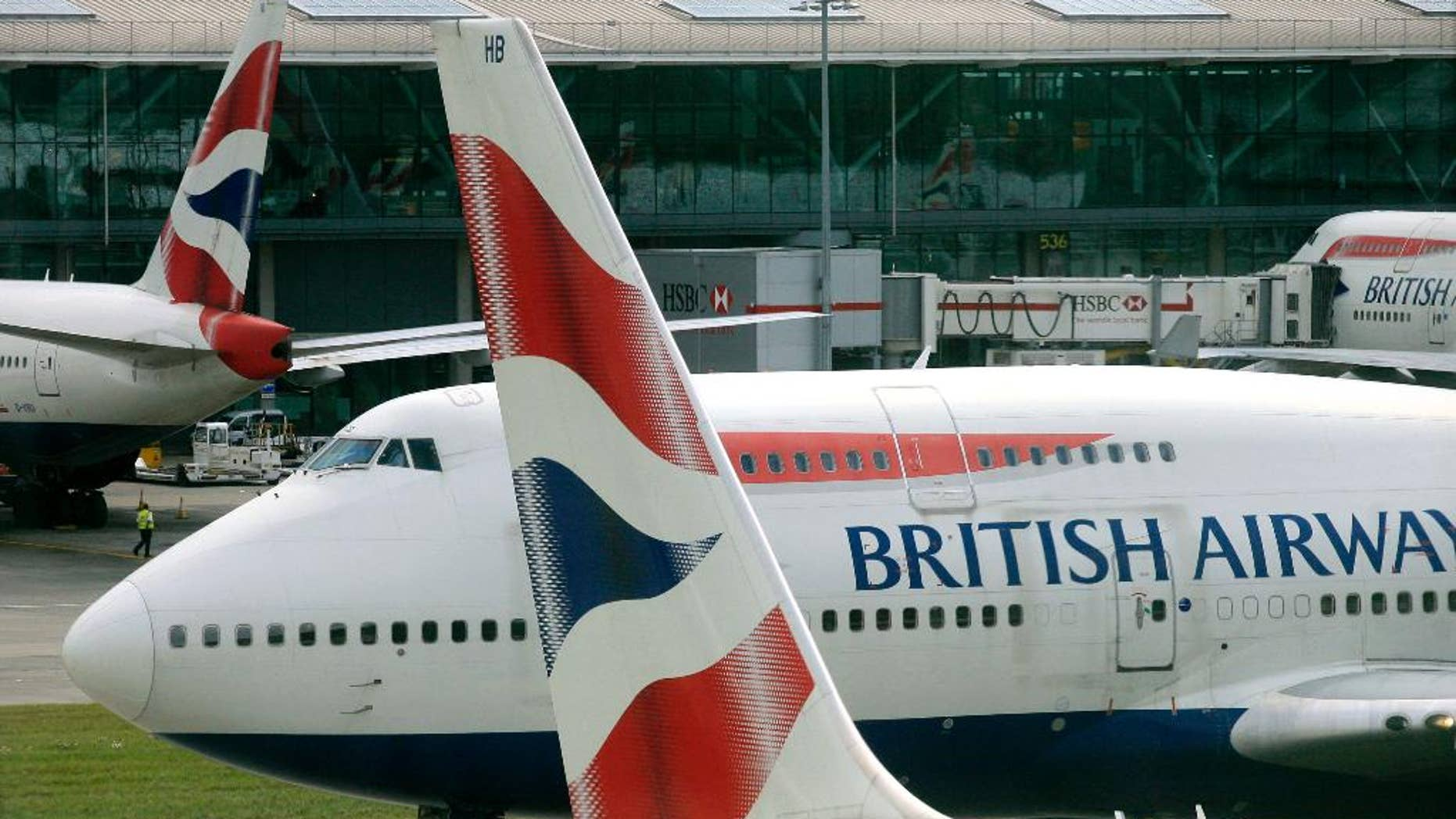 FILE - In this Sunday, Aug. 2, 2009 file photo, a British Airways Boeing 747 taxis away from Terminal 5 at London's Heathrow Airport. Britain's Airports Commission unanimously recommended the construction of a third runway at London's Heathrow Airport on Wednesday, July 1, 2015, in a long-awaited report on how to best expand the country's aviation capacity. The commission decided that Heathrow presented a stronger case for the British economy than rival Gatwick. But it stressed that Europe's largest airport needs to address air quality, noise and community concerns.(AP Photo/Mark Lennihan, file)