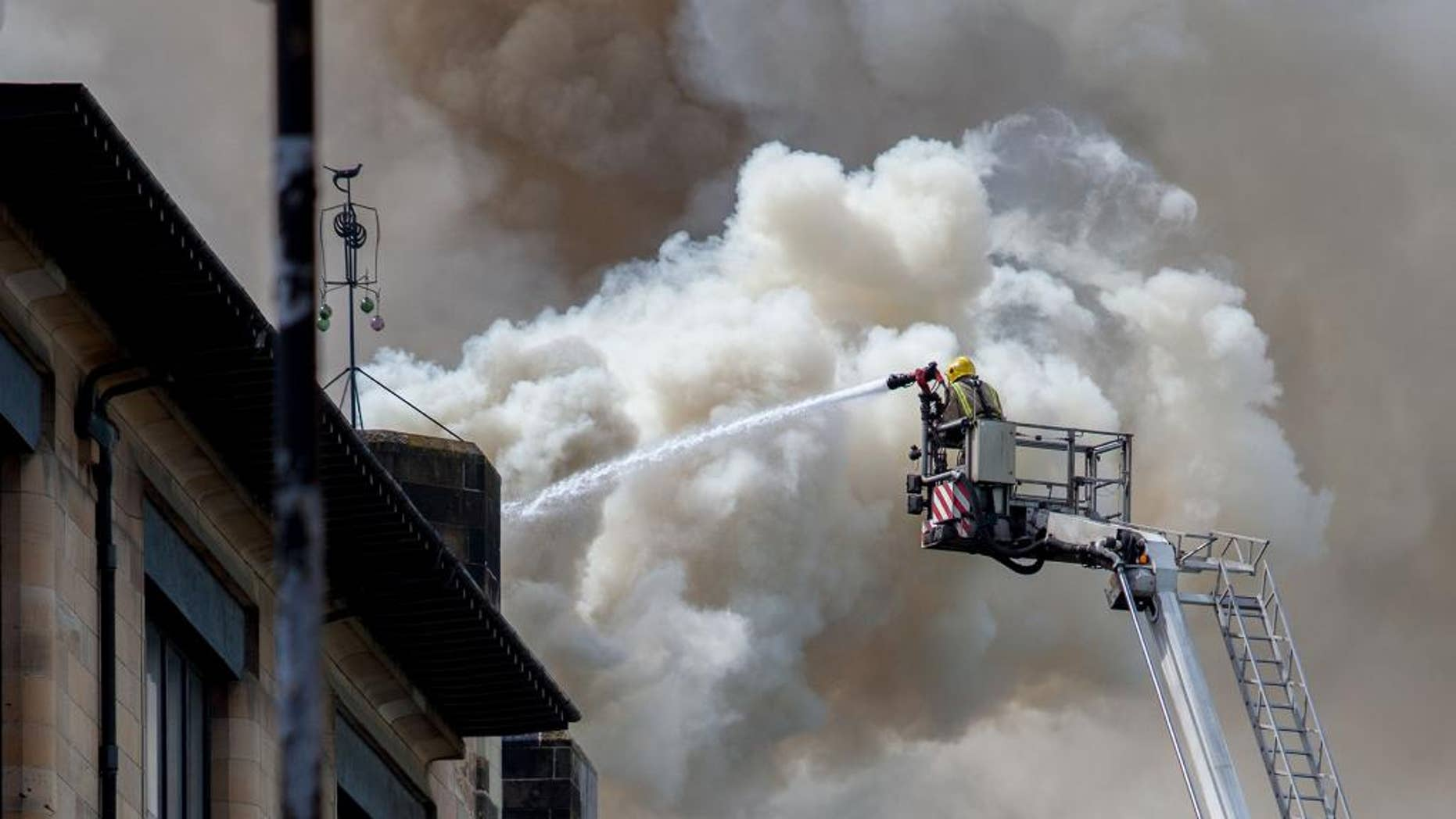 "In this photo released by David Barz , firefighters attend a fire at  Glasgow School of Art, Glasgow, Scotland, Friday, May 23, 2014.    A major fire has devastated the Glasgow School of Art, one of the city's major landmarks. The Scottish Fire and Rescue Service said the blaze, which broke out just after noon on Friday, was a ""very significant fire."" Flames flared through the roof and windows of the sandstone Art Nouveau building, designed by architect Charles Rennie Mackintosh and completed in 1909. A 2009 poll by the Royal Institute of British Architects voted it the best British building of the last 175 years. (AP Photo / David Barz)"
