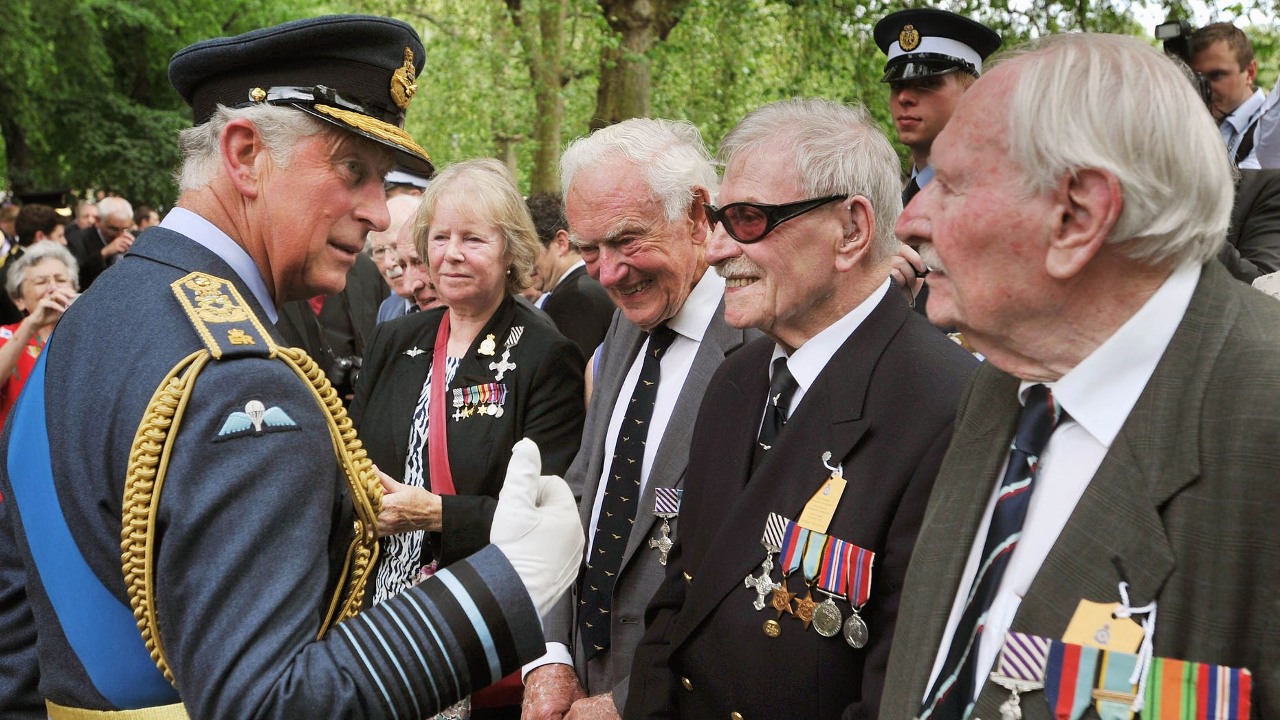 June 28, 2012: Prince Charles, left, speaks with former members of WWII RAF Bomber Command, after Queen Elizabeth II unveiled the Bomber Command Memorial in Green Park.