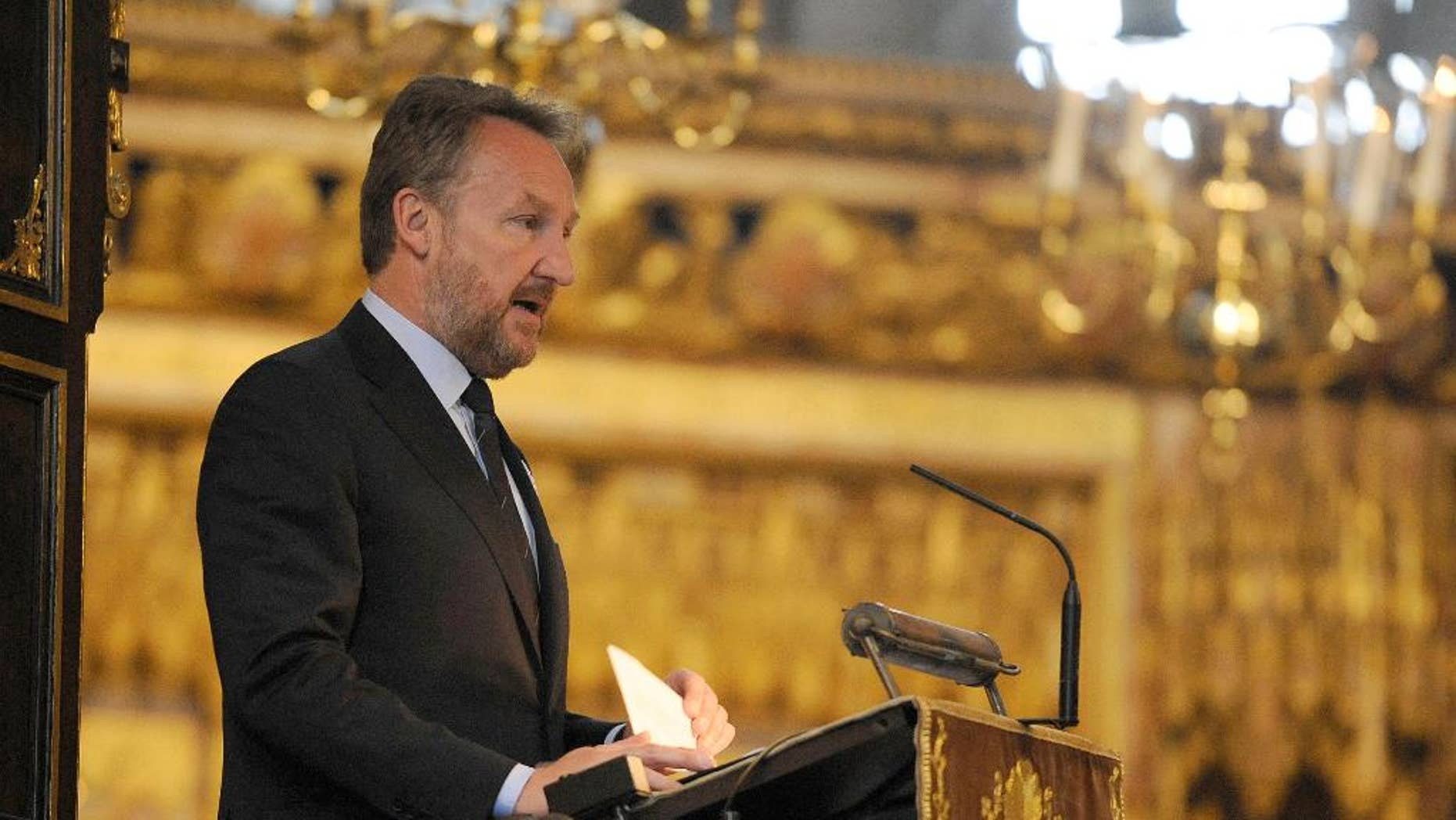 The Muslim Bosniak member of Bosnia's tripartite presidency Bakir Izetbegovic speaks during a  memorial service at Westminster Abbey, London, to mark the  upcoming 20th anniversary of the Srebrenica massacre Monday July 6, 2015.  Days before  anniversary of the Srebrenica massacre, hundreds of Bosnians and Britons attended the memorial service at Westminster Abbey on Monday to remember the more than 8,000 male Muslim victims. (Lauren Hurley/PA via AP) UNITED KINGDOM OUT