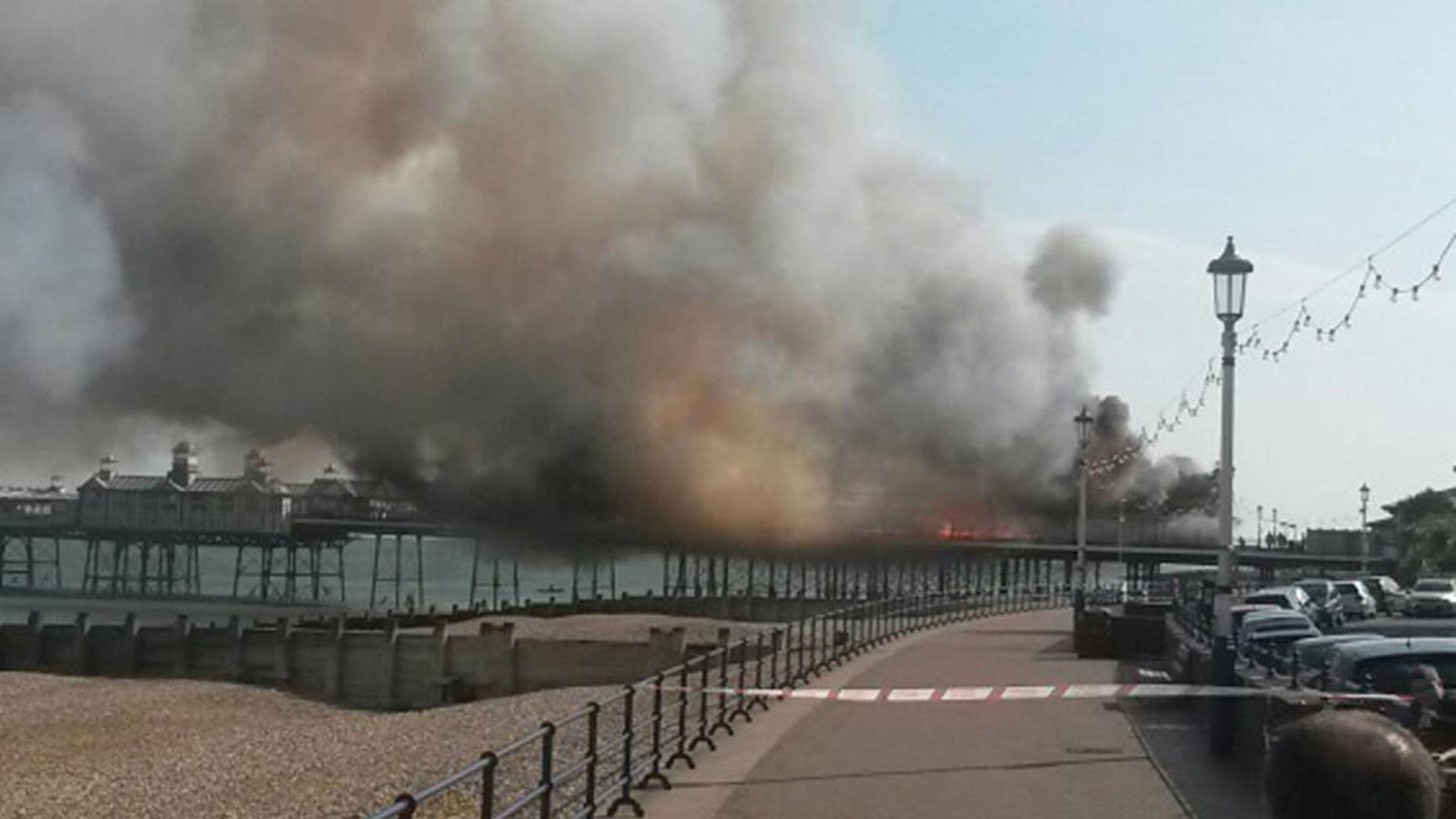 A fire has broken out on Eastbourne Pier, East Sussex, England, Wednesday, July 30, 2014. East Sussex Fire and Rescue Service crews are at the scene of the incident which has been documented by onlookers posting photographs on Twitter. (AP Photo/PA, Tom Pugh) UNITED KINGDOM OUT