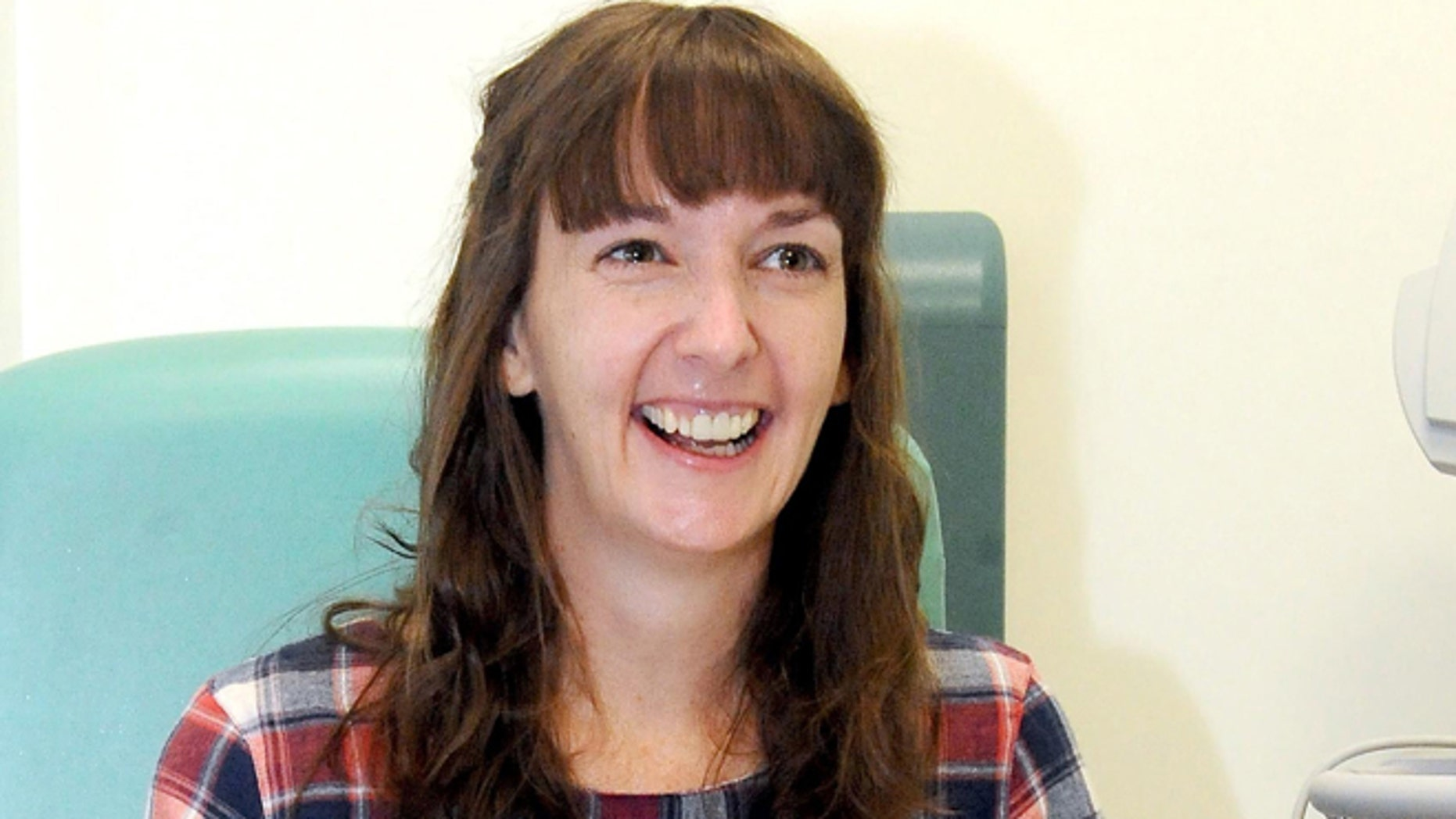 In this file photo, Pauline Cafferkey, a nurse who contracted Ebola while working in Sierra Leone, smiles in the Royal Free Hospital in London.