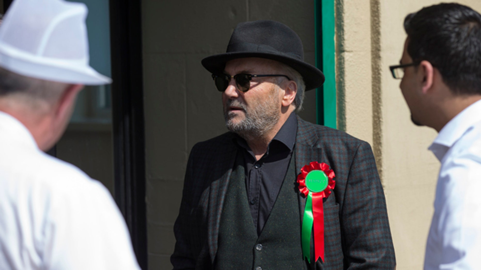 April 22, 2015: Respect Party Leader George Galloway centre, visits Yaadgaar Bakery, in Bradford, England. (AP Photo/Jon Super)
