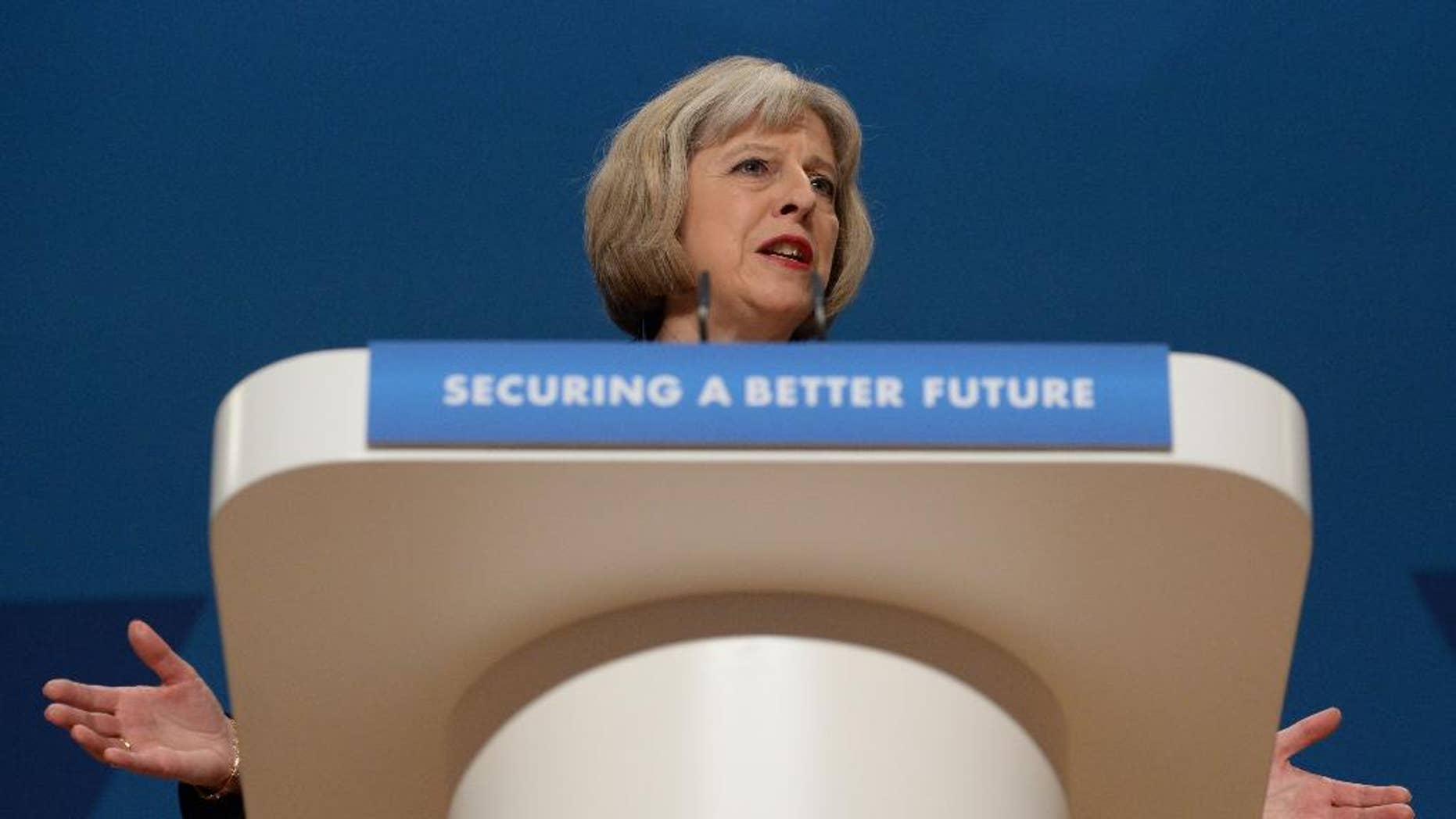 """British Home Secretary Theresa May gives her speech to delegates at the Conservative Party annual conference in Birmingham, England, Tuesday, Sept. 30, 2014. Britain's interior minister says people with extremist views could be barred from appearing on television or publishing on social media even if they are not breaking any laws. Home Secretary Theresa May told a conference of the governing Conservatives that if re-elected next year the party will introduce powers to disrupt people who """"spread poisonous hatred"""" while staying within the law. May said Tuesday that only a minority of extremists are violent, but there is """"a thread that binds"""" nonviolent extremism to terrorism. (AP Photo/Stefan Rosseau, PA Wire)     UNITED KINGDOM OUT      -    NO SALES    -   NO ARCHIVES"""