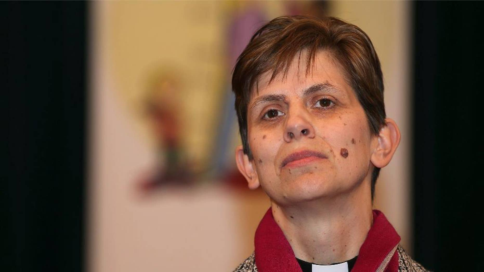 Dec. 17, 2014: Libby Lane pauses as she delivers a speech in the Stockport Town Hall,  after the announcement by the Church of England that she will be appointed as the first female bishop, in Stockport, England.