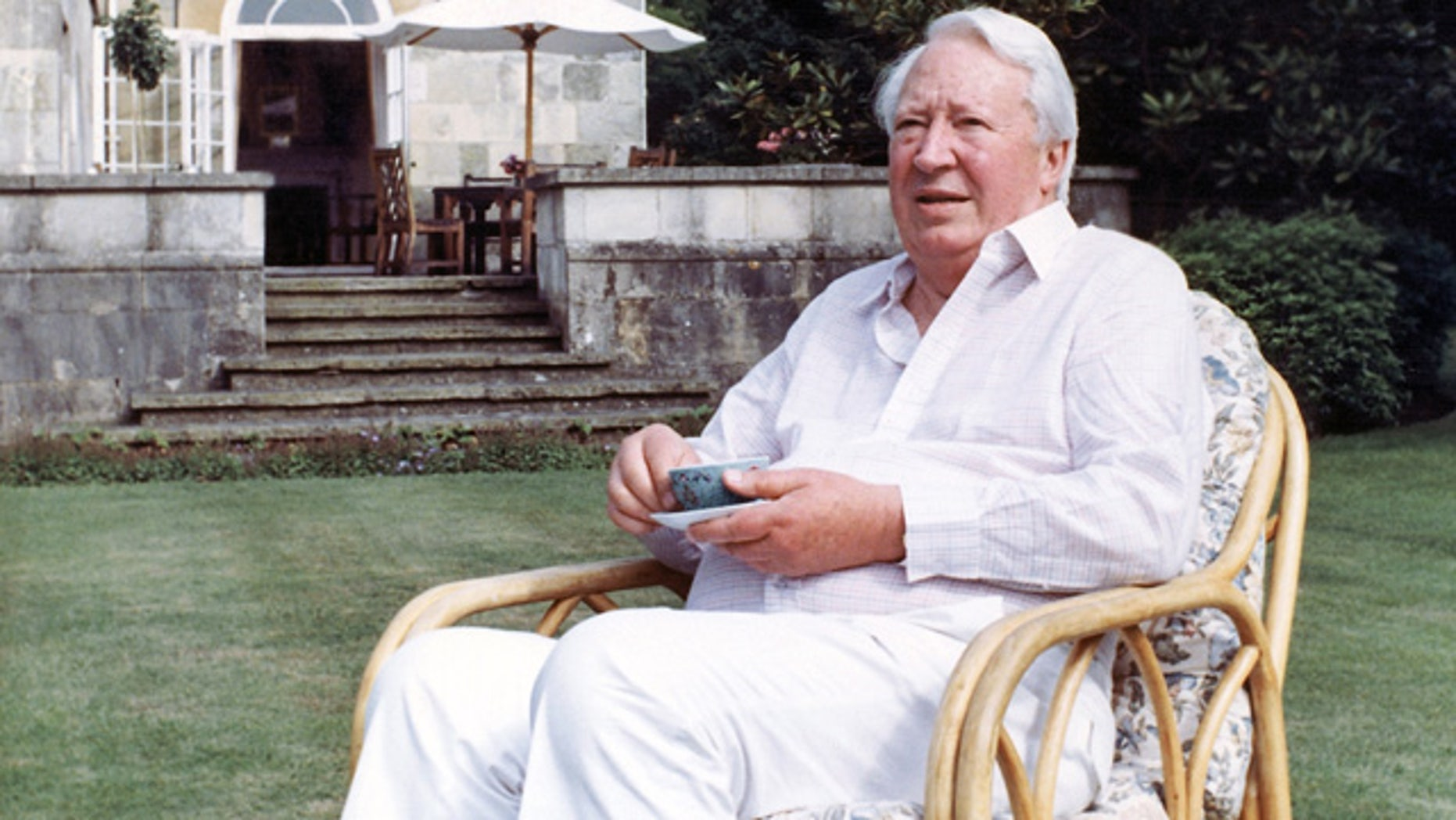 FILE - This is a July 19, 1989 file photo of former  British Prime Minister Edward Heath as he takes tea in the garden of his home in Salisbury, England. (AP Photo/Martin Cleaver/File)