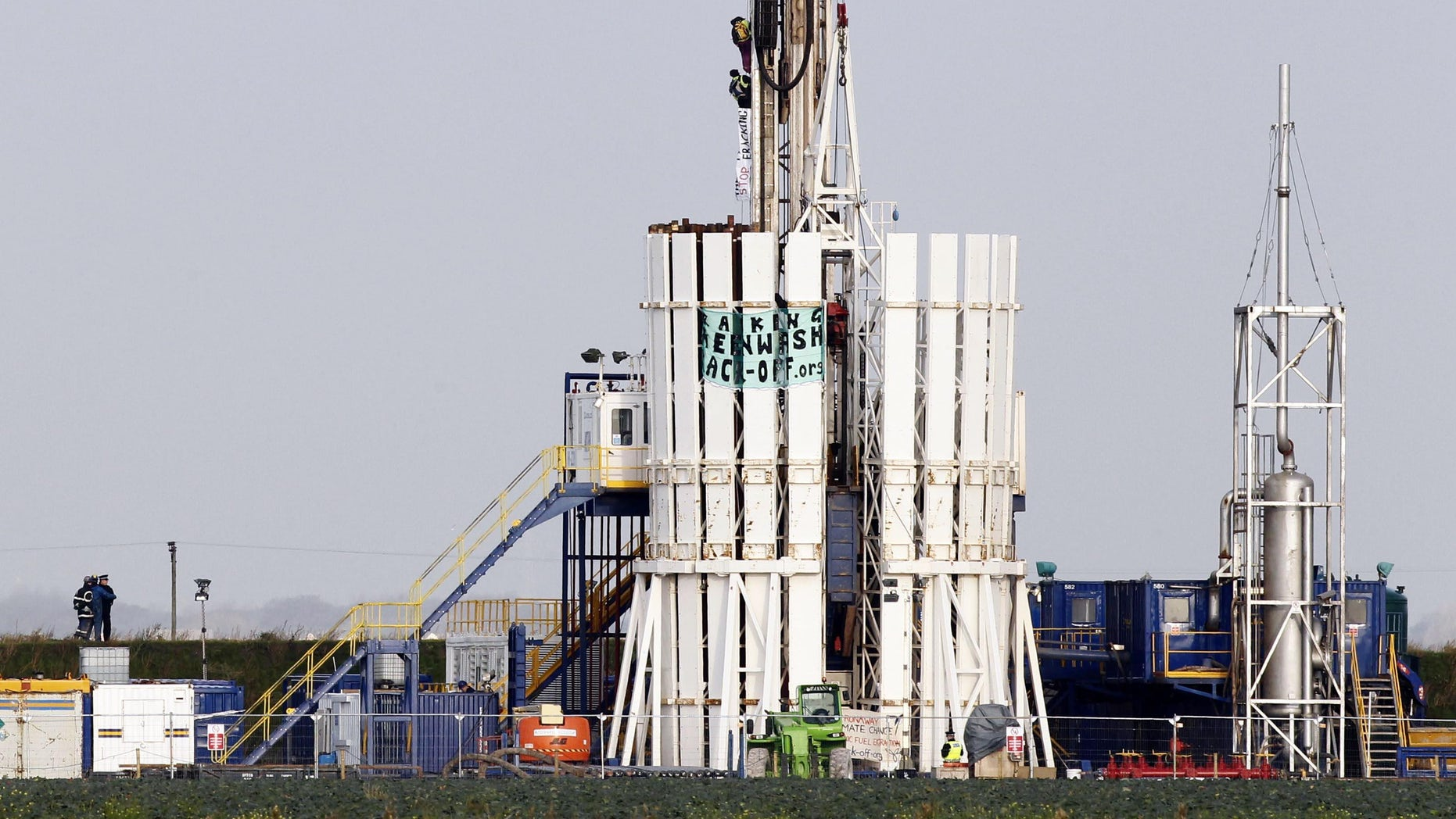 Nov. 2, 2011: Protestors scale a shale gas rig at Banks, near Southport, England bringing a halt to work at the Cuadrilla Resources site.