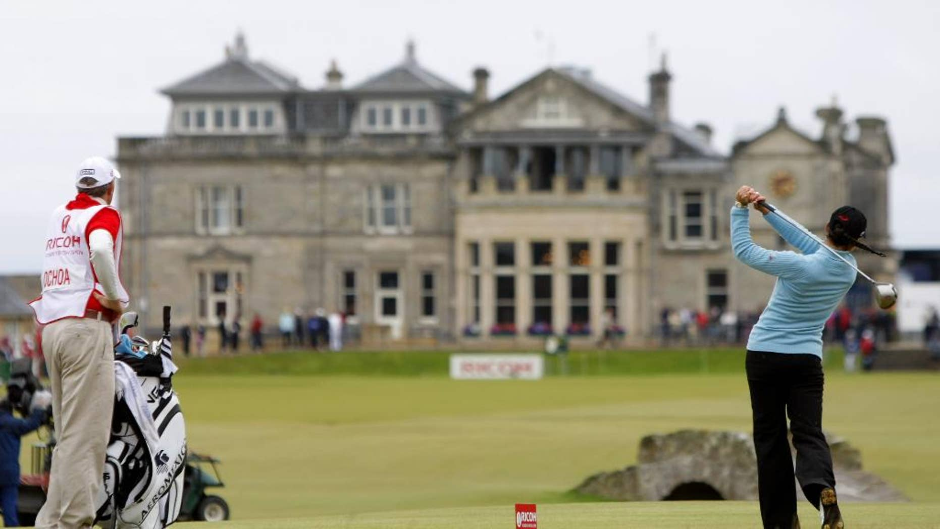 FILE - This is a  Sunday, Aug. 5, 2007 file photo of tournament winner and world number one Mexico's Lorena Ochoa as she tees off from the 18th with the St Andrews clubhouse in the background, during the Women's British Open golf tournament on the Old Course at the Royal and Ancient Golf Club in St Andrews, Scotland.  The Royal & Ancient could finally be allowing women to join one of the most influential golf clubs.  The Daily Mail newspaper on Wednesday March 26, 2014 cited a letter from the R&A to its 2,500 members recommending they change the all-male membership policy at St. Andrews.  (AP Photo/Matt Dunham, File)
