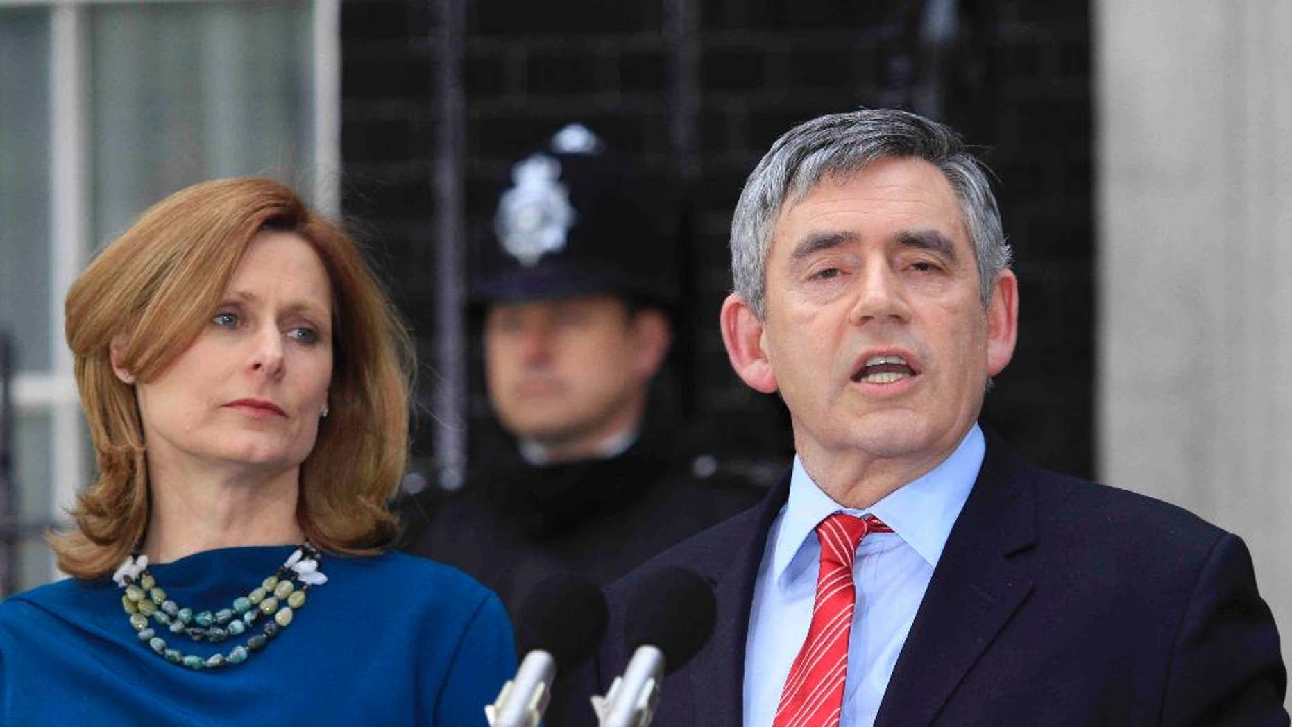 FILE - In this Tuesday May 11, 2010 file photo, Britain's Prime Minister Gordon Brown, accompanied by his wife Sarah, announces his resignation outside his official residence at No. 10 Downing Street in central London. Rivals and allies are paying tribute to former British Prime Minister Gordon Brown, who plans to step down from Parliament at a national election in May. Brown is due to make a speech Monday Dec. 1, 2014 in his home town of Kirkcaldy, Scotland. British media say he will announce he is leaving Parliament after 32 years.  (AP Photo/Lefteris Pitarakis, File)