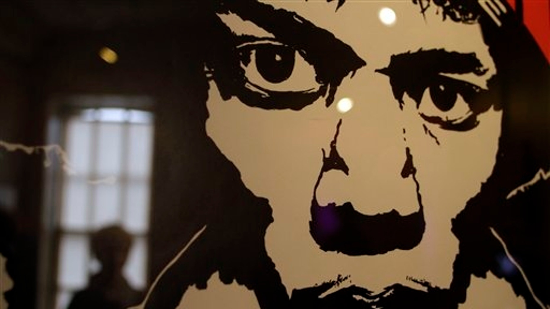 A vintage concert poster depicting late US musician Jimi Hendrix, is seen in a exhibition at the Handel House Museum, in central London's Mayfair area. (AP)
