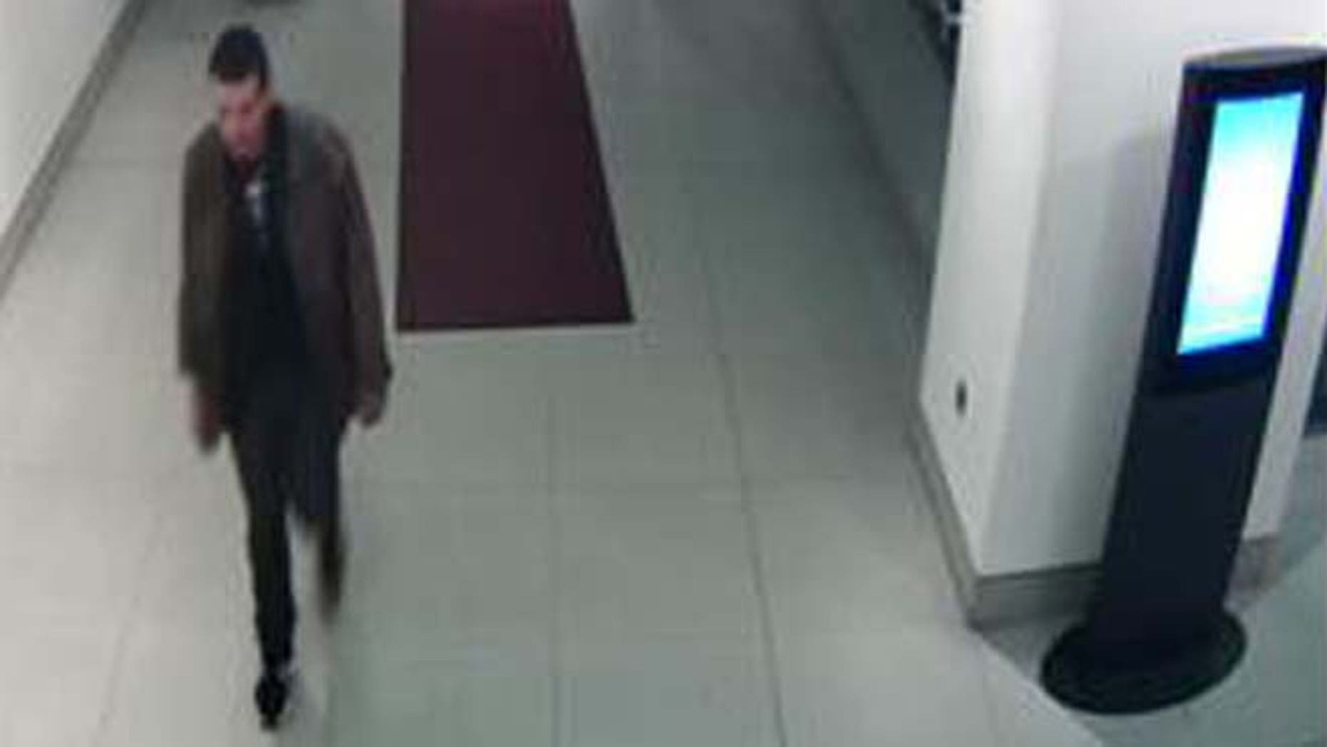 In this image taken from CCTV and made available April 6, 2014 from Britain's Metropolitan Police, showing 32-year old Philip Spence entering the lobby of the Cumberland Hotel in London before he savagely beat three sisters in a ''sustained and vicious'' hammer attack as they slept with their young children in the luxury hotel.  (AP/ Metropolitan Police)