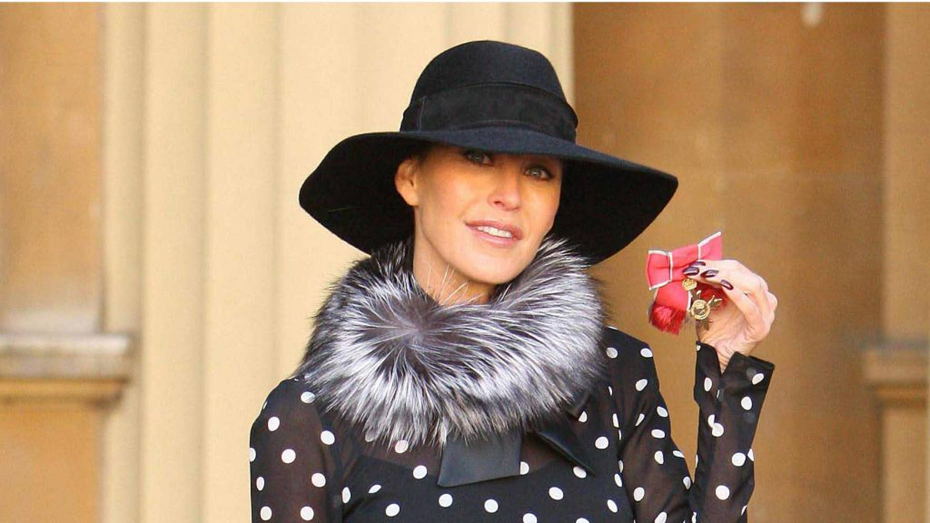 """FILE-  In this Wednesday Oct. 20, 2010 file photo, Britain's Tamara Mellon, co-founder of Jimmy Choo, displays her OBE, which was awarded by Britain's Queen Elizabeth II, at an investiture ceremony at Buckingham Palace, London. Luxury shoemaker Jimmy Choo has announced plans to list at least a quarter of its shares on the London Stock Exchange next month in Oct. 2014. The designer label, which recorded sales of 282 million pounds ($462 million) in 2013, said it is looking to expand in Asia and other new markets, and plans to open 10 to 15 stores per year. Malaysian-born designer Jimmy Choo and the brand's co-founder Tamara Mellon opened their first store in London in 1996. It is now owned by private investment firm JAB Luxury, which acquired it in 2011, and the label now has 120 stores worldwide. Peter Harf, non-executive chairman of Jimmy Choo, said in a statement Tuesday the company is """"confident that shareholders can expect strong growth and cash flow in the years to come.""""  (AP Photo/Dominic Lipinski, Pool, file)"""