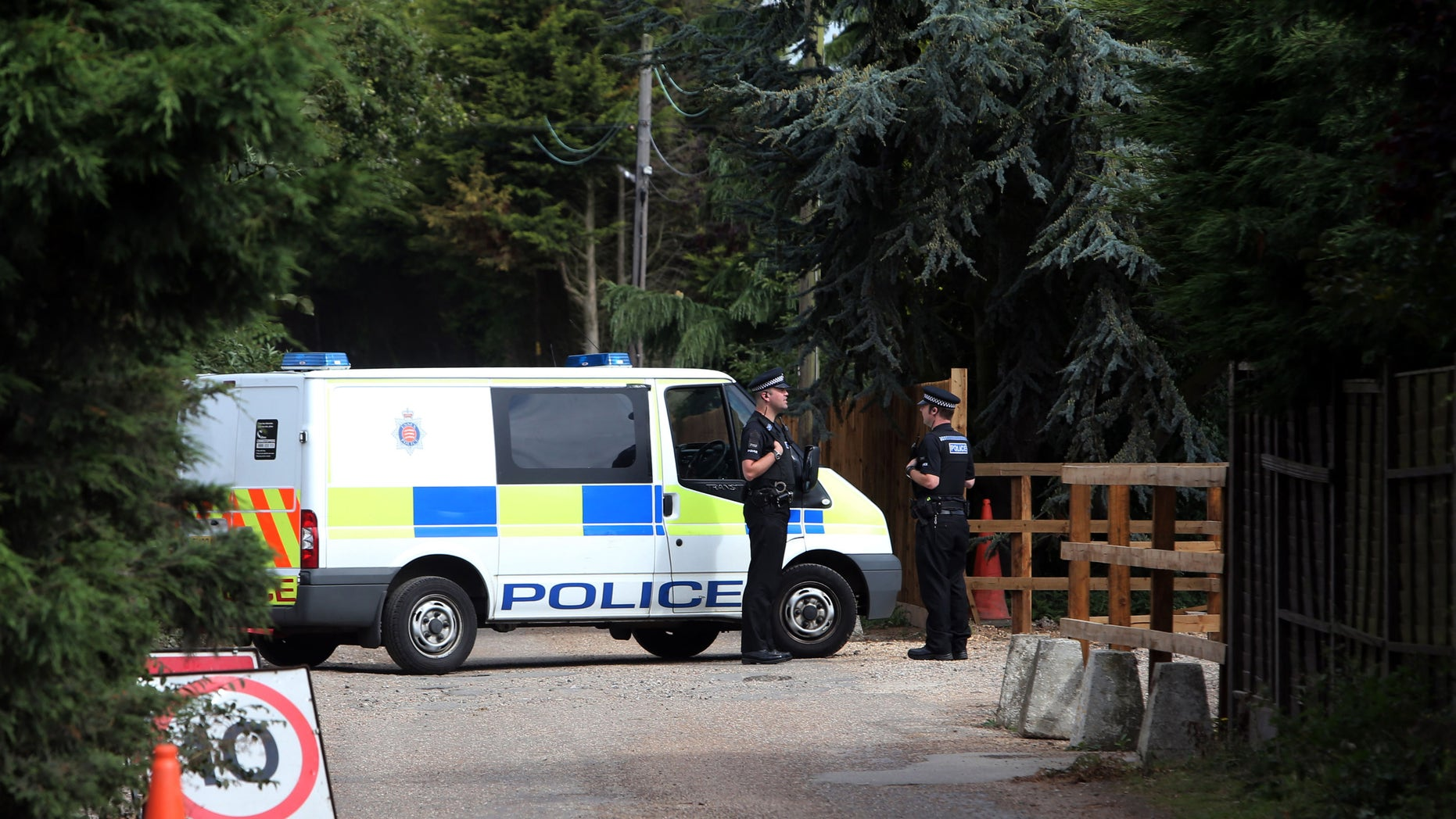 Aug. 27, 2012: Police stand at Earls Hall Farm in St Osyth, southern England where a lion was apparently seen.