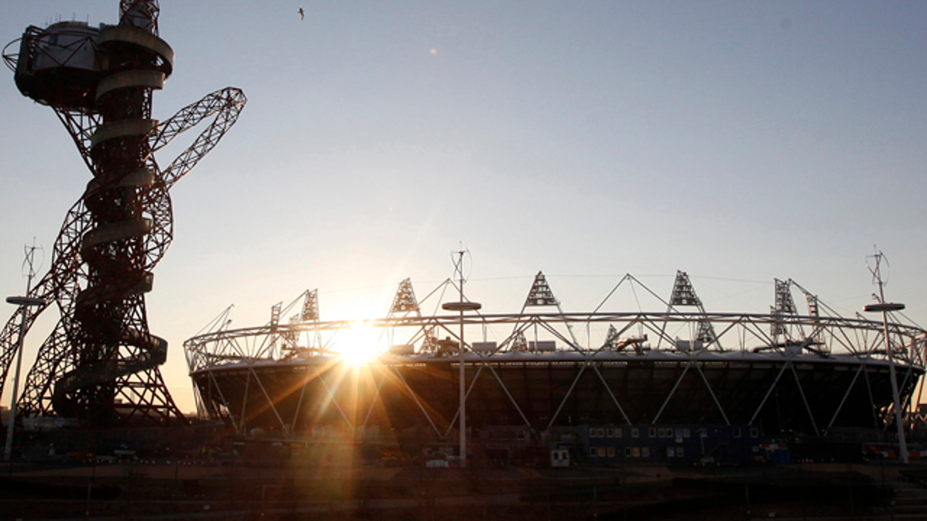 Feb. 23, 2012: In this file photo the London 2012 Olympic Stadium is seen at about sunset, with the partially completed ArcelorMittal Orbit at the Olympic Park in London.