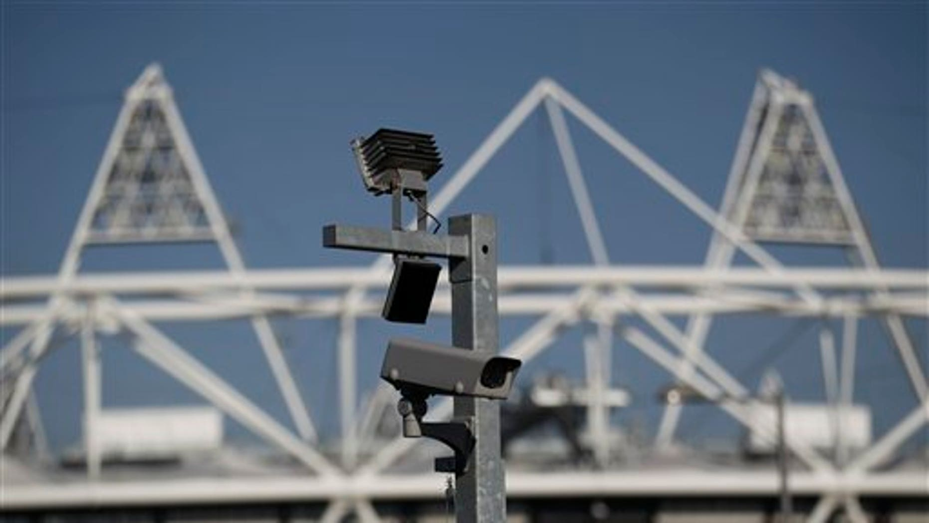 March 28, 2012: A security cctv camera is seen by the Olympic Stadium at the Olympic Park in London.