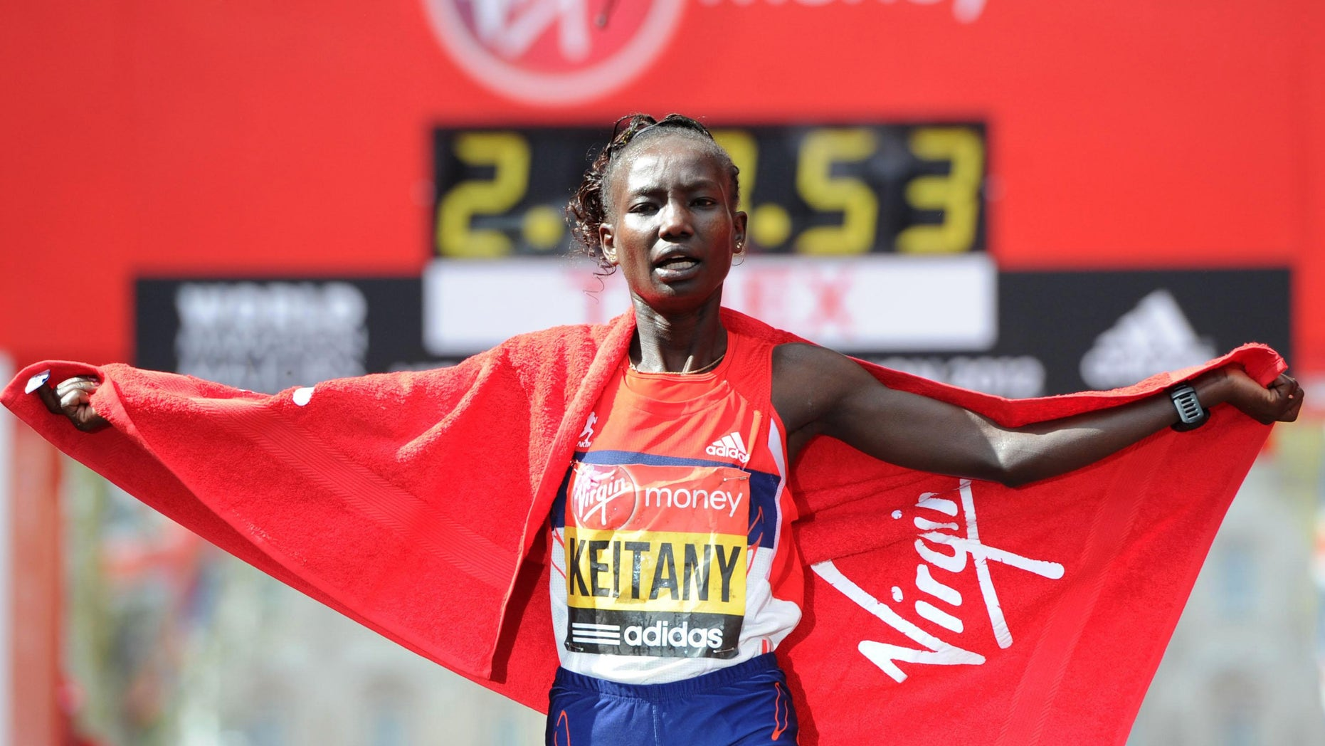 April 22, 2012: Kenya's Mary Keitany celebrates winning the women's race during the 2012 London Marathon for the second year during the 32nd London Marathon in London.