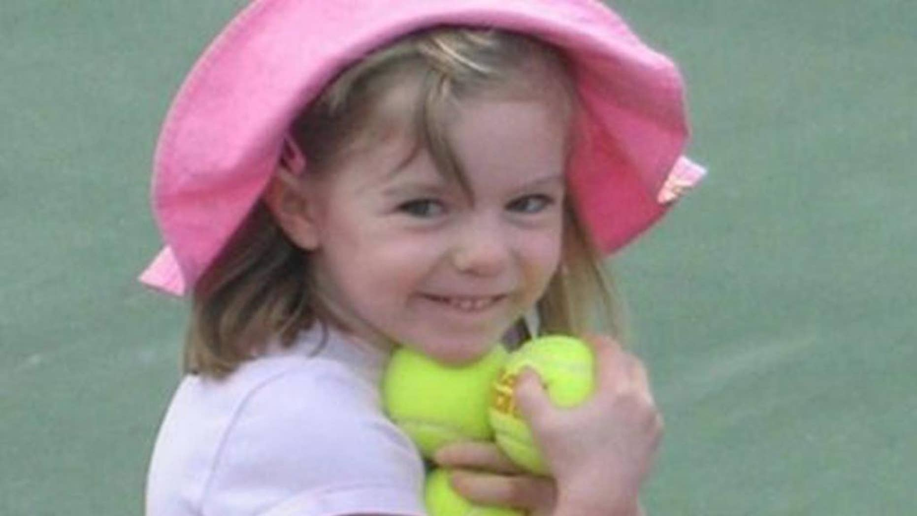 FILE - This undated  file photo made available by the London Metropolitan Police, shows missing British girl Madeleine McCann before she went missing from a Portuguese holiday complex .  British police investigating the disappearance of Madeleine McCann said Wednesday March 19, 2014, they are seeking an intruder who sexually assaulted five girls in the region of southern Portugal where the British toddler was last seen.  (AP Photo/London Metropolitan Police)