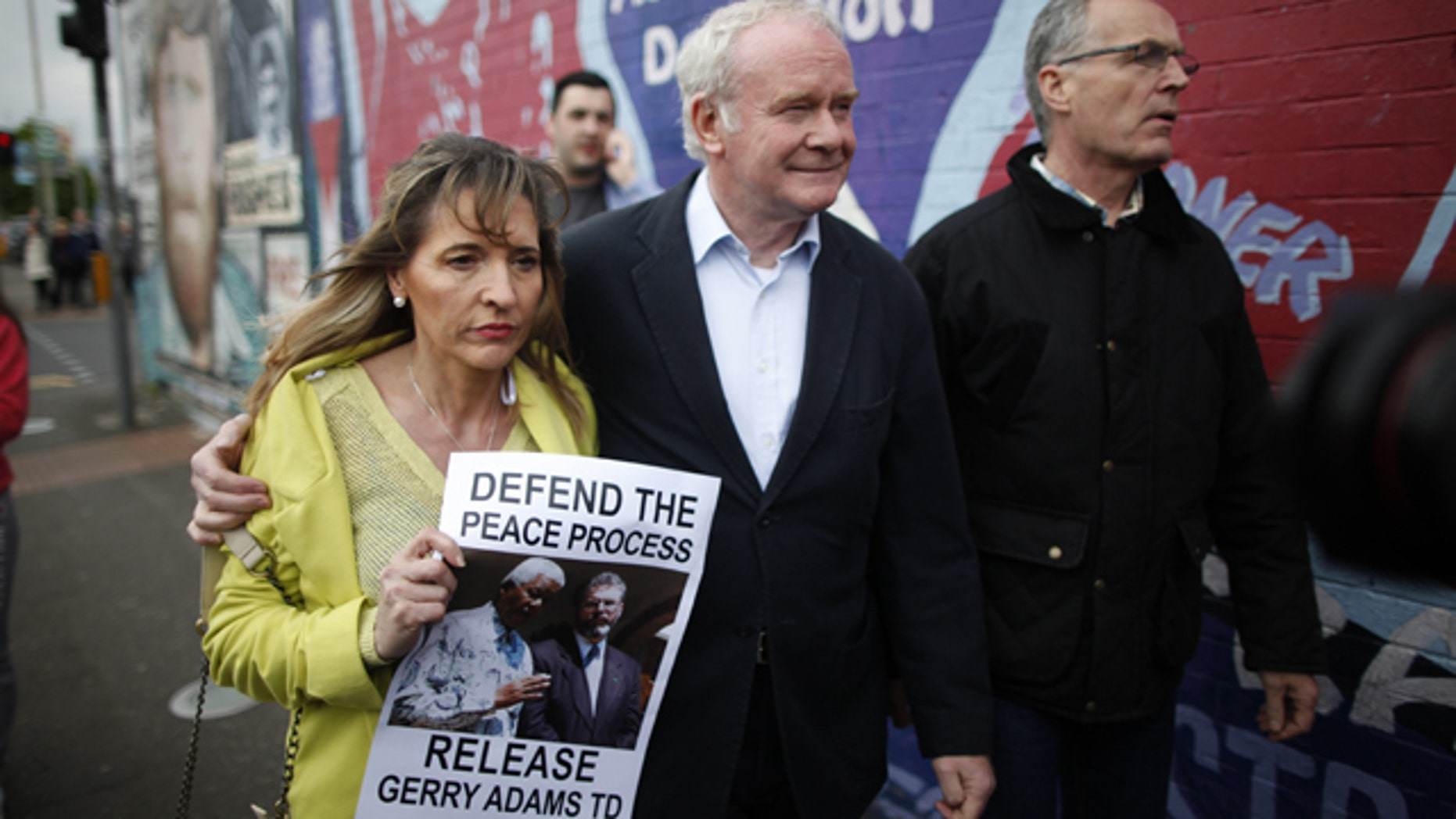 May 3, 2014: Sinn Fein's Martin McGuinness, center, with party members Bobby Storey, right, and Martina Anderson as they arrive for a protest rally on the Falls Road, West Belfast, Northern Ireland.