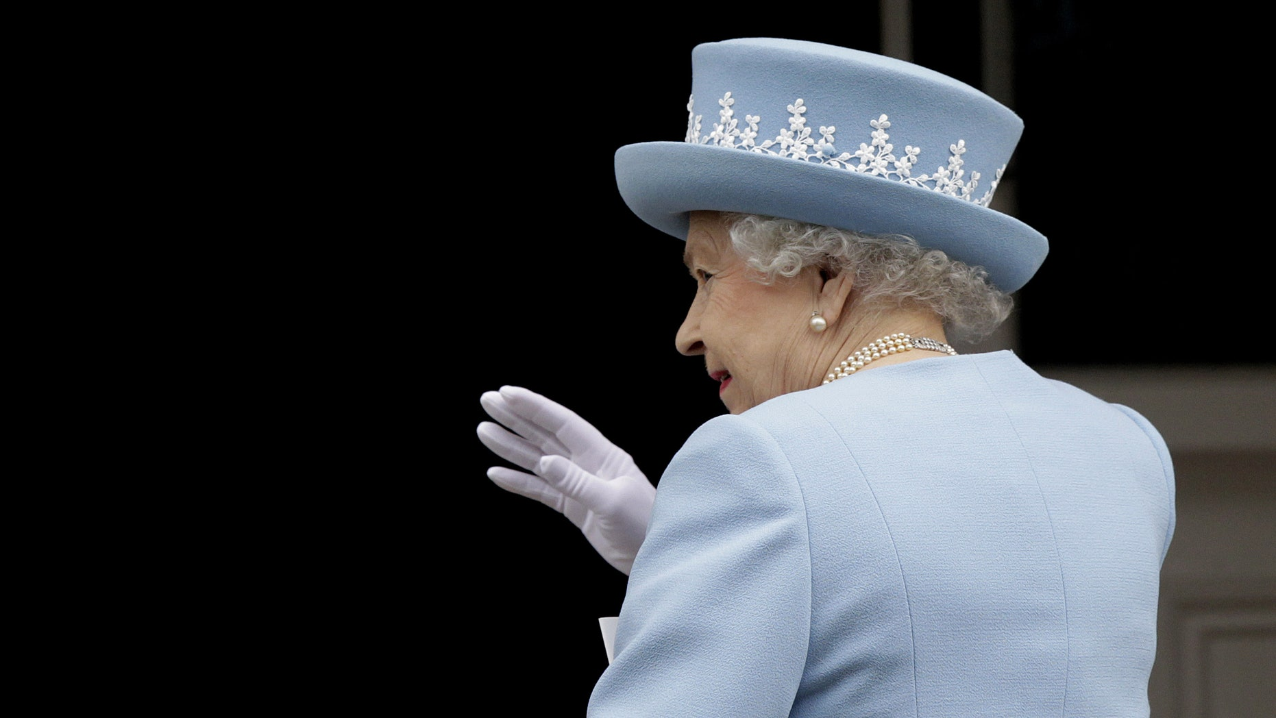 June 26, 2012: Britain's Queen Elizabeth II waves to the public as she arrives for a Service of Thanksgiving in Saint Macartin's Cathedral in Enniskillen, Northern Ireland.