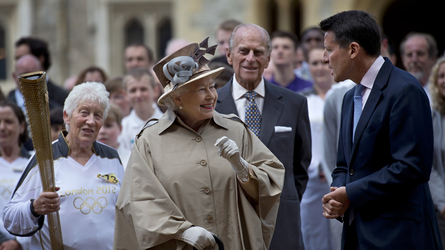 July 10, 2012: Britain's Queen Elizabeth II, second left, her husband Prince Philip, second right, London 2012 Chairman Sebastian Coe, right, and seventy four year-old Olympic torch bearer Gina Macgregor,  left, at Windsor Castle, Windsor, England.
