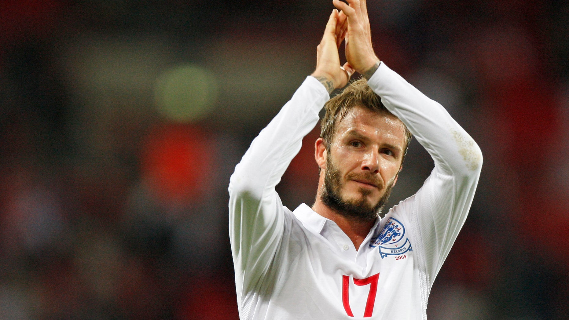 Oct. 14, 2009: This file photo shows England's David Beckham applauding the crowd after their World Cup group 6 qualifying soccer match against Belarus at Wembley Stadium, London.