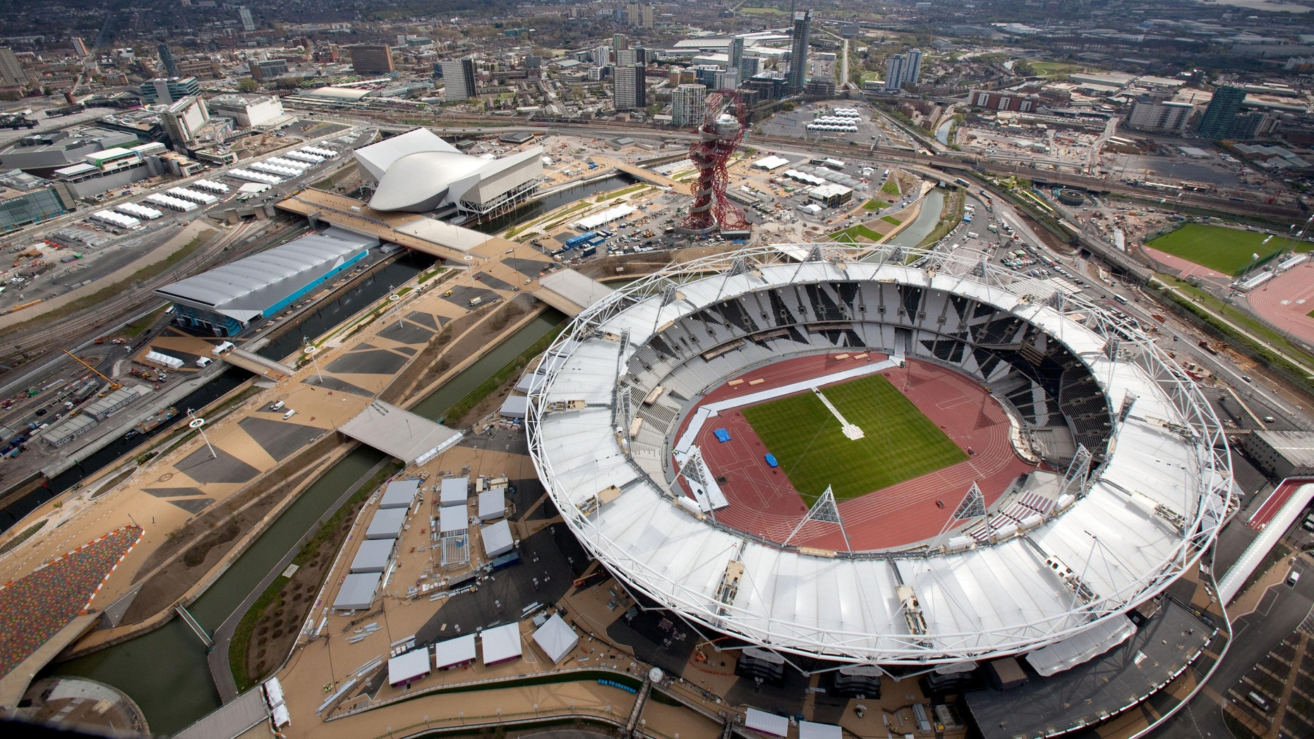 """The London Games will be the most tweeted, micro-blogged, liked and tagged in history, with fans offered a never before seen insider's view of what many are calling the social media Olympics, or the """"socialympics."""" (AP Photo)"""