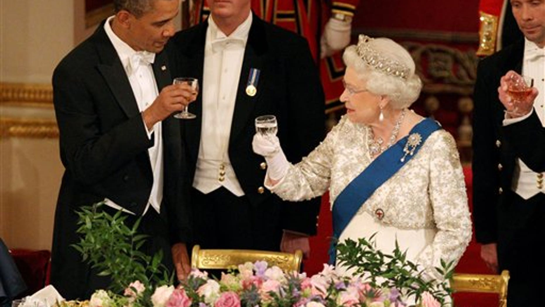 May 24: Britain's Queen Elizabeth II, and U.S. President Barack Obama during a state banquet in Buckingham Palace, London. President Barack Obama immersed himself in the grandeur of Britain's royal family Tuesday, as Queen Elizabeth II welcomed him to Buckingham Palace for the first day of a state visit. (AP/Pool)