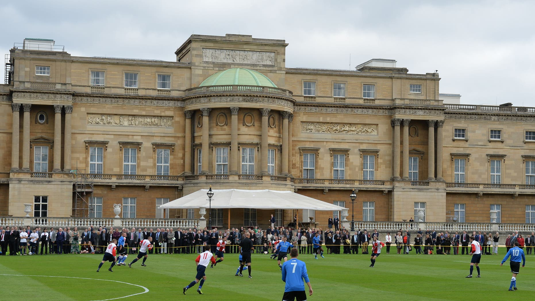 Oct. 7, 2013. - Polytechnic FC (in blue), during their match with the Civil Service FC in Buckingham Palace's garden, central London. The Duke of Cambridge helped organize the event, the first of its kind at Queen Elizabeth II's London home, as part of the Football Association's 150th anniversary celebrations.
