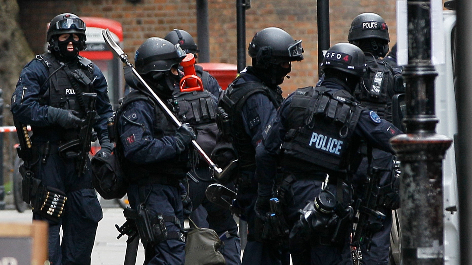 April 27, 2012: Armed police carry equipment outside a building near Tottenham Court Road in central London after an incident was reported in the area.