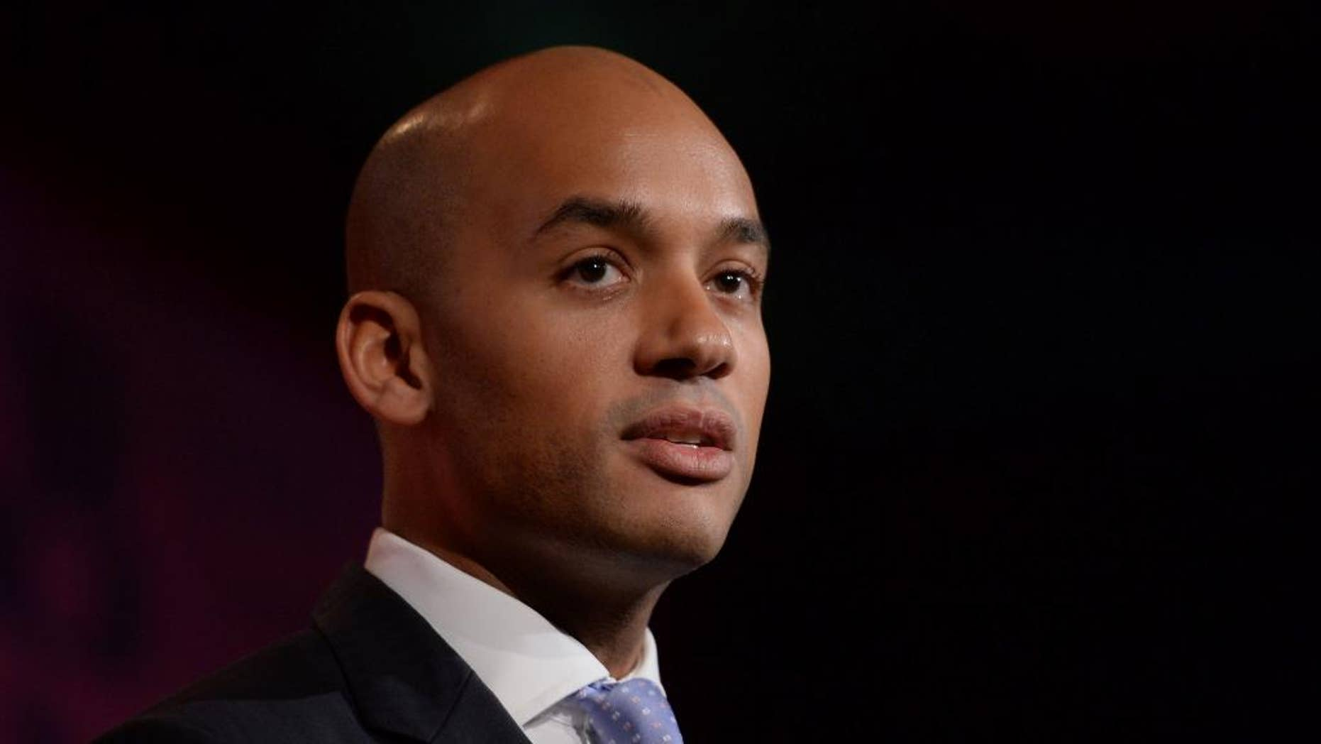 """FILE  - This Tuesday, Feb. 10, 2015 file photo shows Britain's Shadow business secretary Chuka Umunna delivering a speech in London. An up-and-coming British politician who was considered a front-runner to replace Labour leader Ed Miliband abruptly withdrew from the contest Friday, May 15, 2015, saying he had underestimated the intense scrutiny to which he would be subjected. Chuka Umunna, who announced his leadership bid just three days ago, blamed the """"added level of pressure that comes with being a leadership candidate."""" (Anthony Devlin/Pa via AP, file)    UNITED KINGDOM OUT     -    NO SALES     -     NO ARCHIVES"""