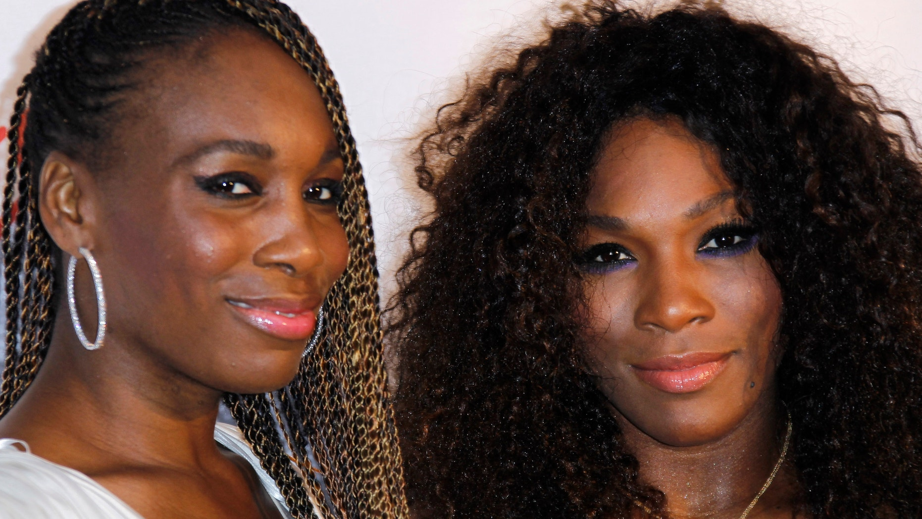 The Williams sisters, pictured here at a pre-Wimbledon party on June 21, 2012, will attempt to extend their undefeated streak in doubles at this year's Olympics. (AP Photo)