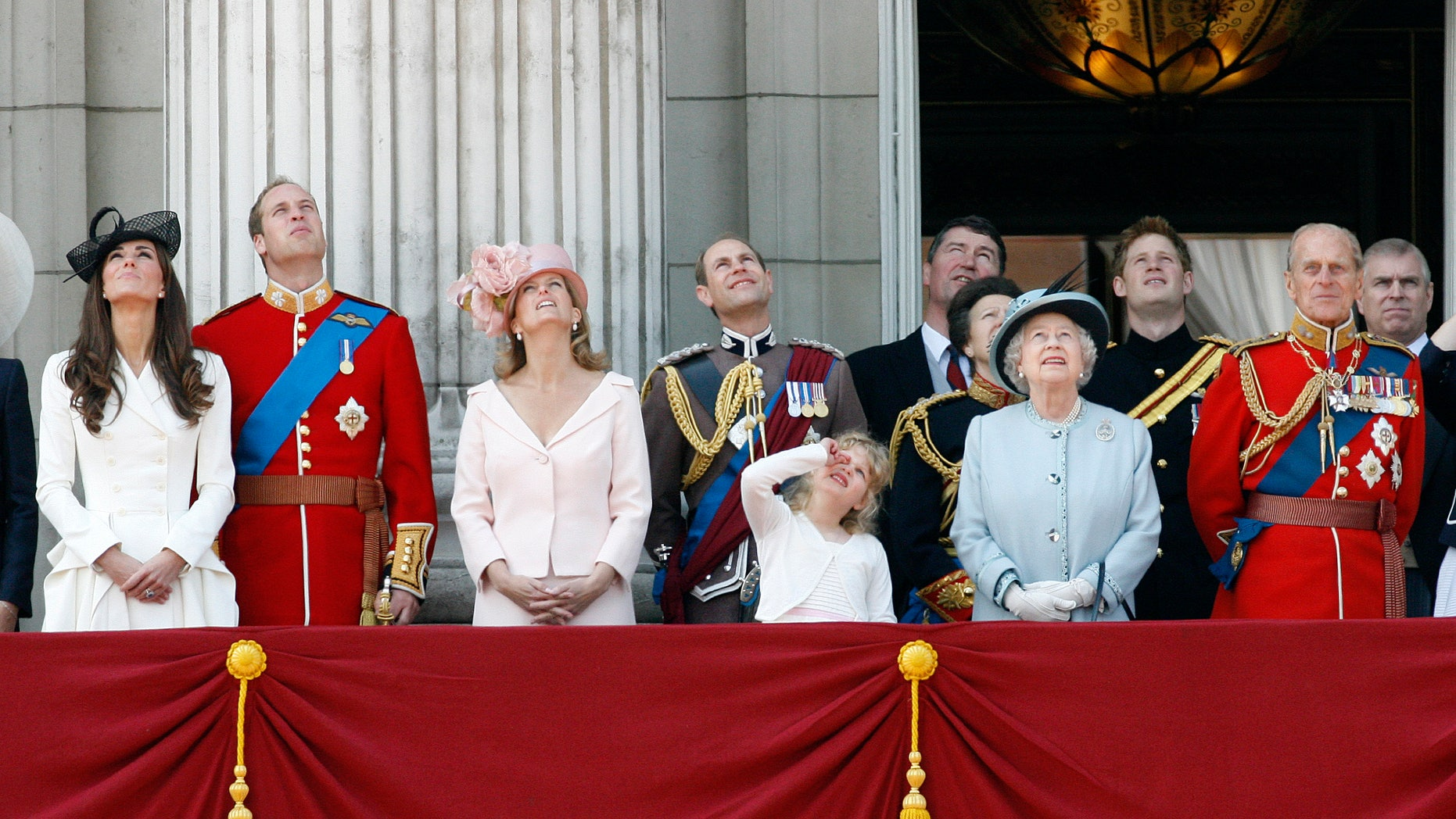 June 11, 2011: Britain's Duchess of Cambridge, Prince William the Duke of Cambridge, Countess of Wessex Sophie, Prince Edward the Earl of Wessex, their daughter Louise, Princess Anne, partially seen, her husband Tim Lawrence, Britain's Queen Elizabeth II, Prince Harry, Prince Philip the Duke of Edinburgh, and Prince Andrew, watch a Royal Air Force flypast on the balcony of Buckingham Palace.