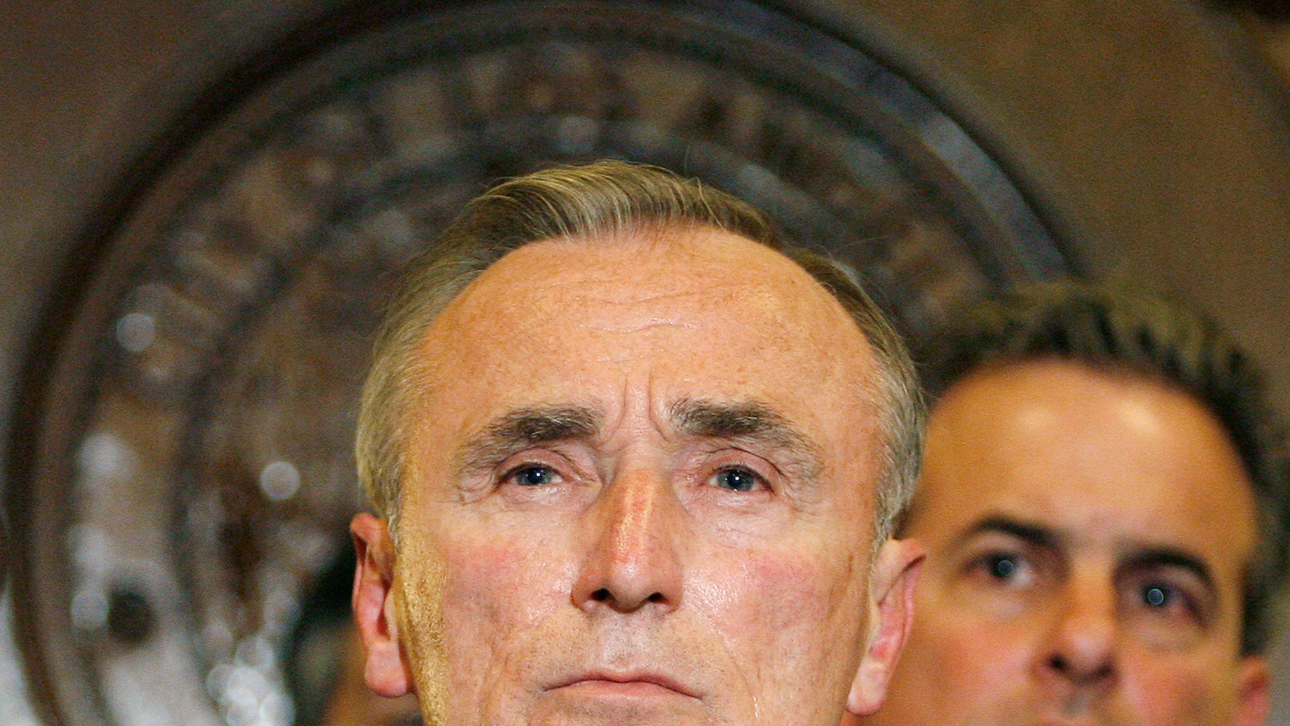 May 2, 2007: Former Los Angeles Police Chief William J. Bratton, left, takes a question during a news conference with city leaders at Los Angeles City Hall. Britain's Prime Minister David Cameron said Thursday his country would look to the United States for solutions to gang violence after nights of riots and looting.