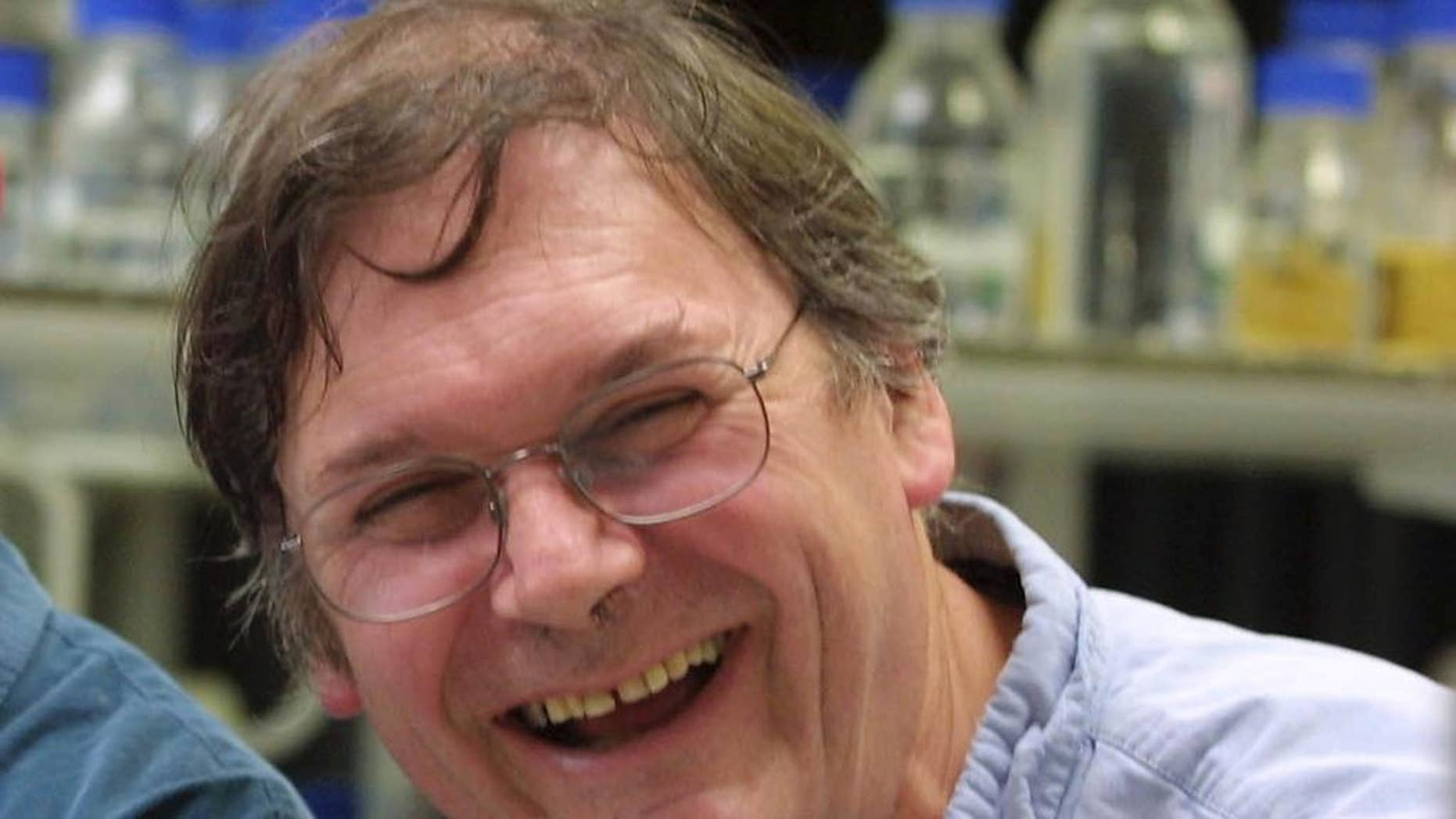 """FILE - A Monday Oct. 8, 2001 photo from files of Dr. Tim Hunt, winner of the Nobel Prize for Medicine, in a laboratory in London. The Nobel Prize-winning British scientist has apologized Wednesday, June 10, 2015, for saying the """"trouble with girls"""" working in science labs is that it leads to romantic entanglements and harms science. Tim Hunt made the comments at the World Conference of Science Journalists in South Korea, according to audience members. (AP Photo/Alastair Grant, File)"""