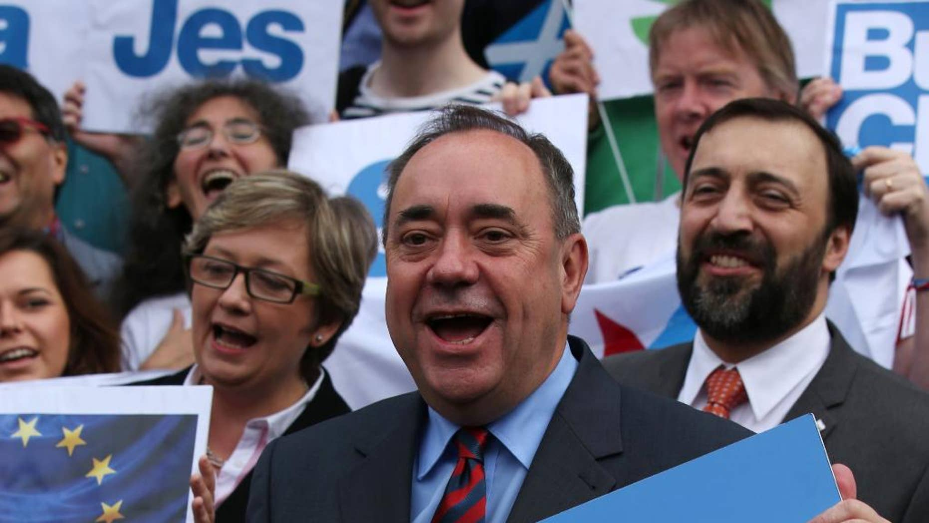 """Scottish First Minister Alex Salmond meets with Scots and other European citizens to celebrate European citizenship and """"Scotland's continued EU membership with a Yes vote"""" at  Parliament Square in Edinburgh, Scotland, Tuesday, Sept. 9, 2014. Opinion polls showing that the independence referendum in Scotland is too close to call have prompted widespread selling of the British pound. If the actual vote on Sept. 18 delivers a knockout blow to Scotland's 307-year union with England, that selling could become even more pronounced as the United Kingdom is likely plunged into the biggest constitutional crisis in its history. The fate of the British pound, which has been one of the most tangible links of the union, will be front and center of the separation proceedings as it has been for the past few months during the cut and thrust of the campaign. (AP Photo/Andrew Milligan, PA Wire)     UNITED KINGDOM OUT   -   NO SALES    -    NO ARCHIVES"""