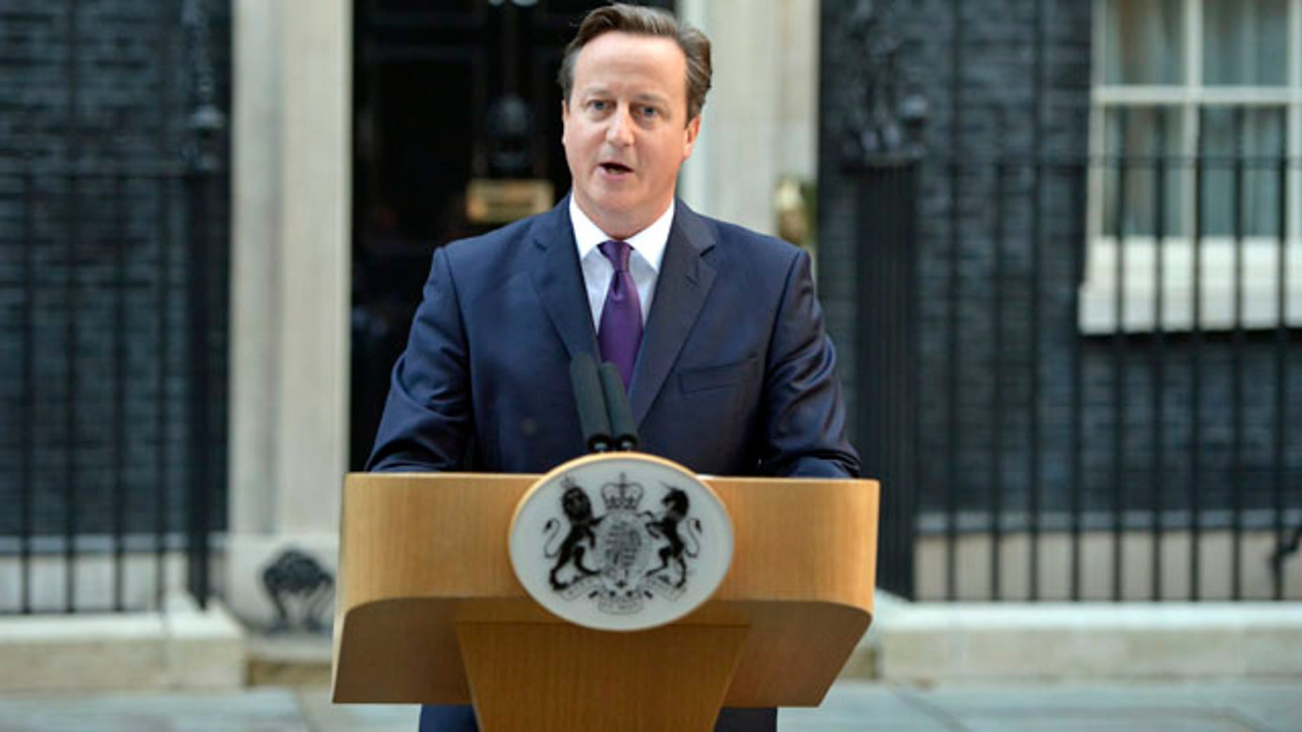 September 19, 2014: British Prime Minister David Cameron makes a statement regarding the result of the Scottish independence referendum in Downing Street in central London. (AP Photo/PA, Dominic Lipinski)