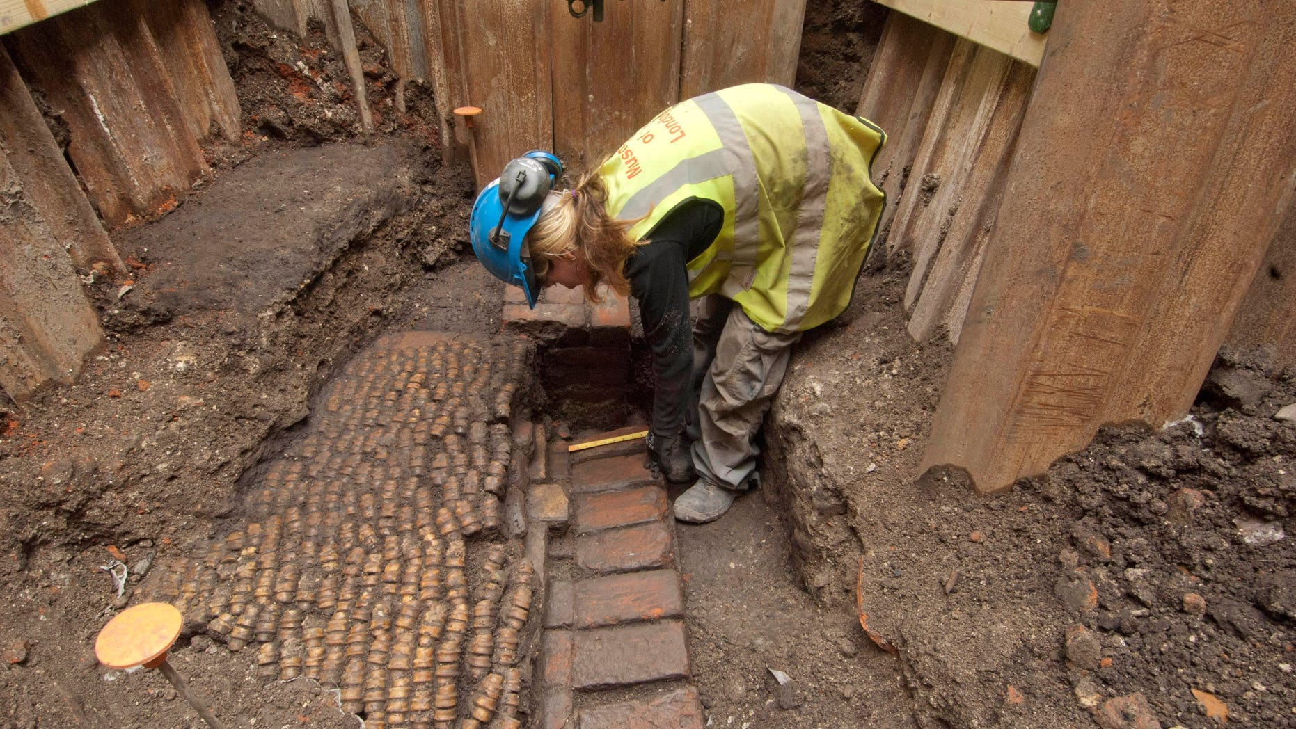 June 6, 2012: An archaeologist undertakes initial excavation work at the site of The Curtain Theatre in London in October 2011.